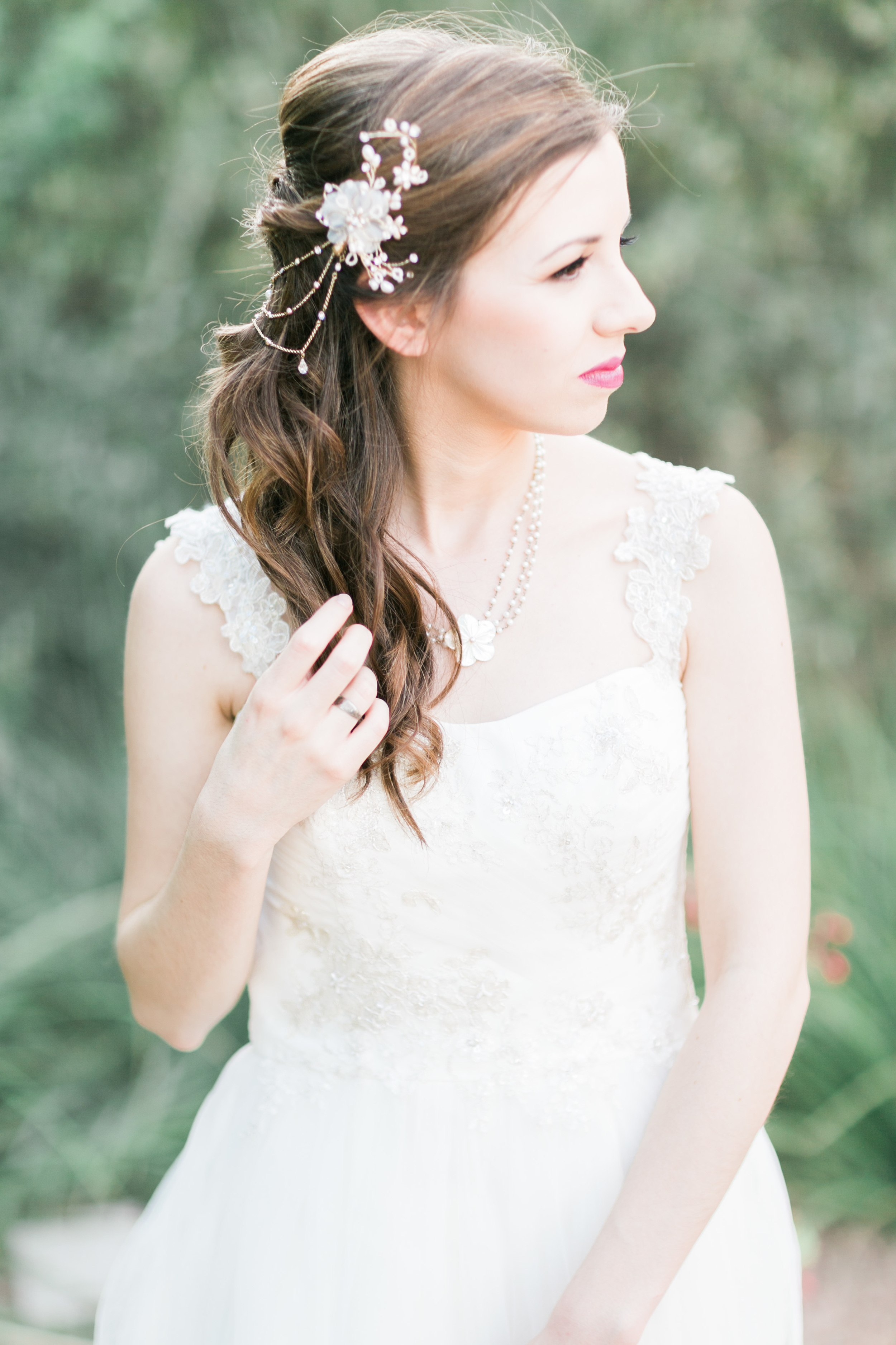 Beautiful bride with ornate floral hair clip