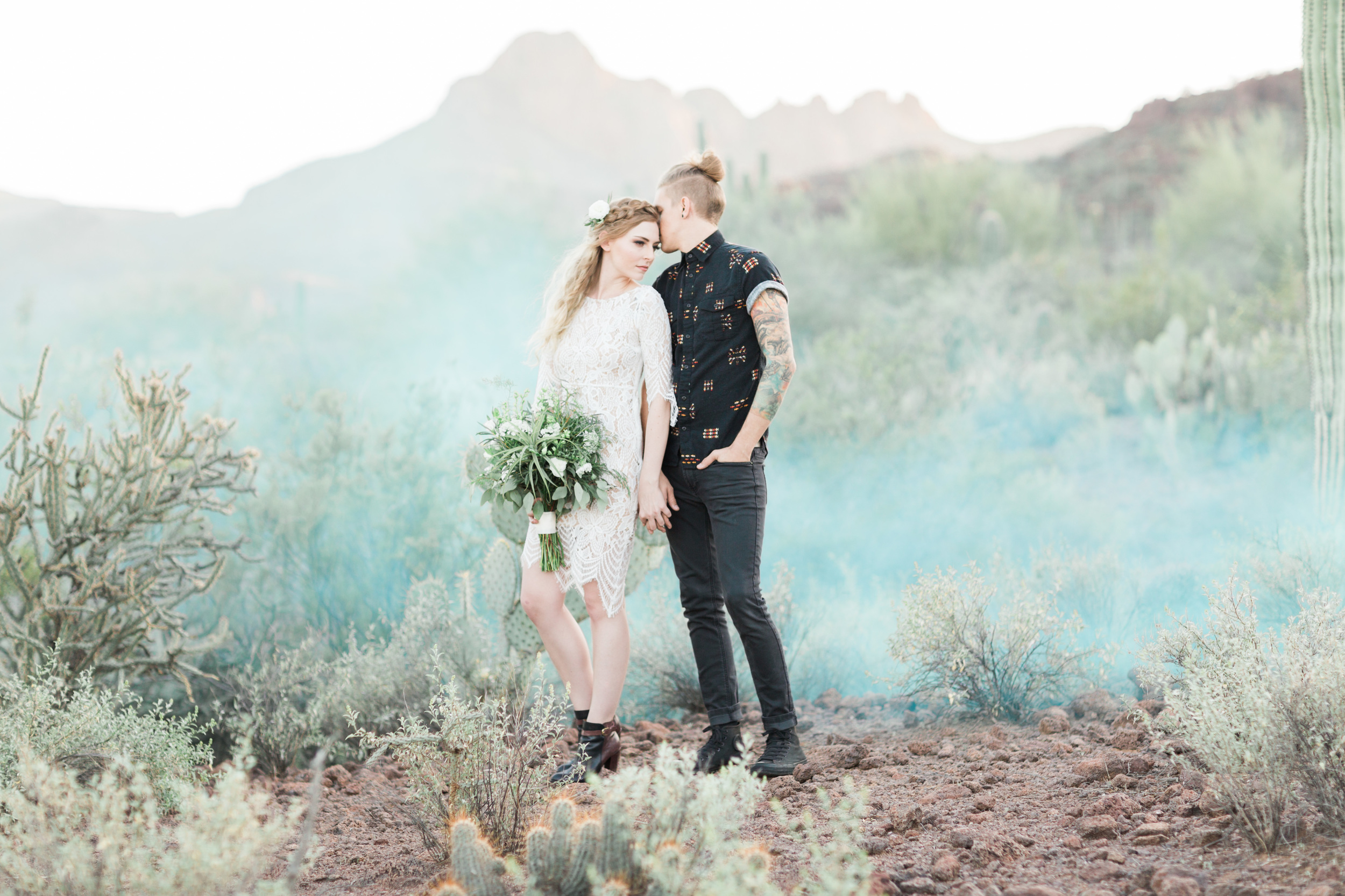 Romantic desert anniversary session with cactus and blue smoke bombs