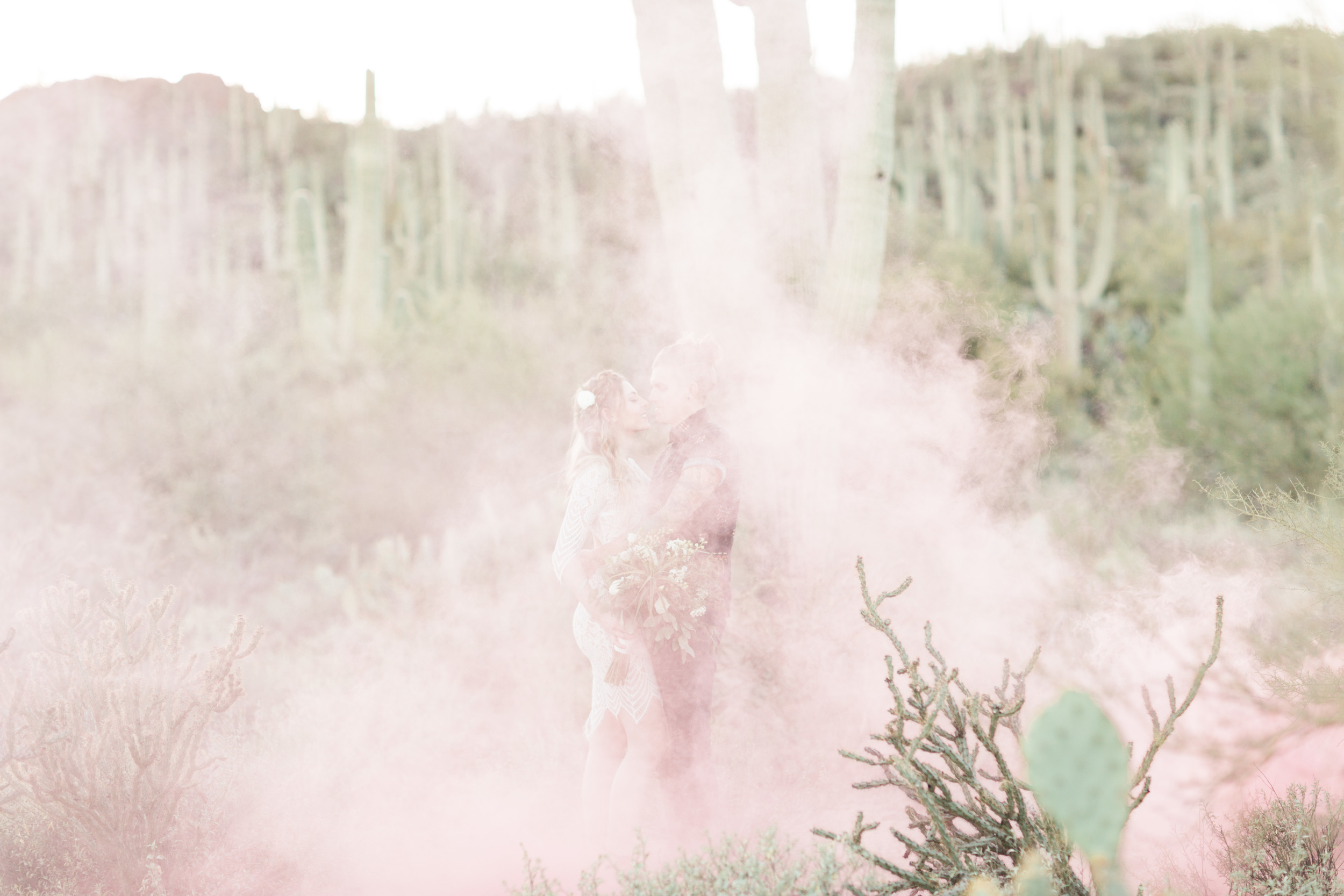 Pink smoke bombs in the desert