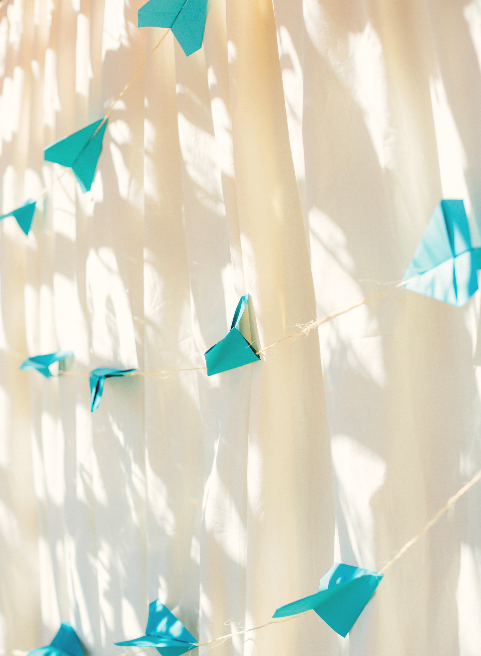 Paper airplanes backdrop for the cake table