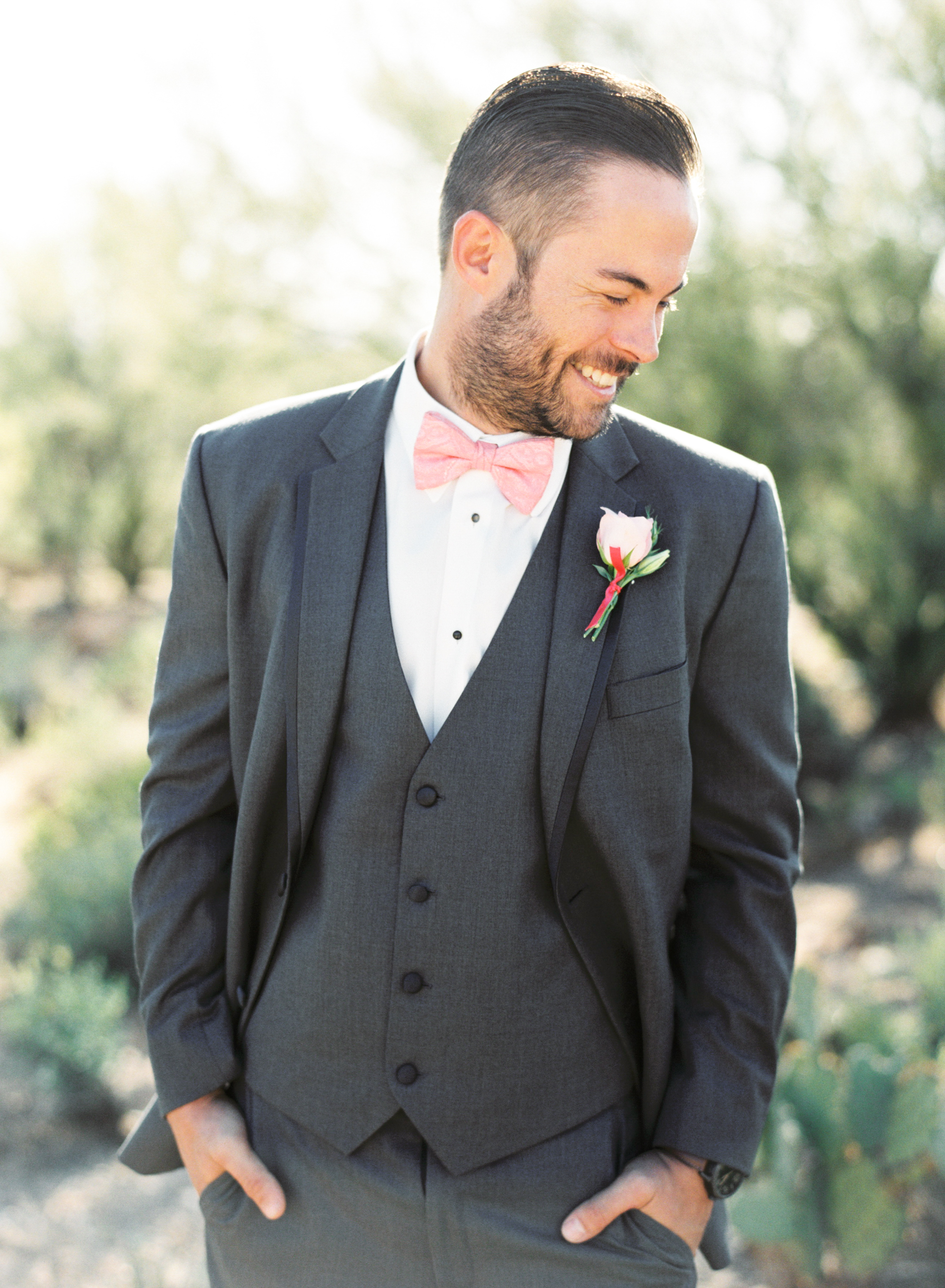 Handsome groom in gray suit