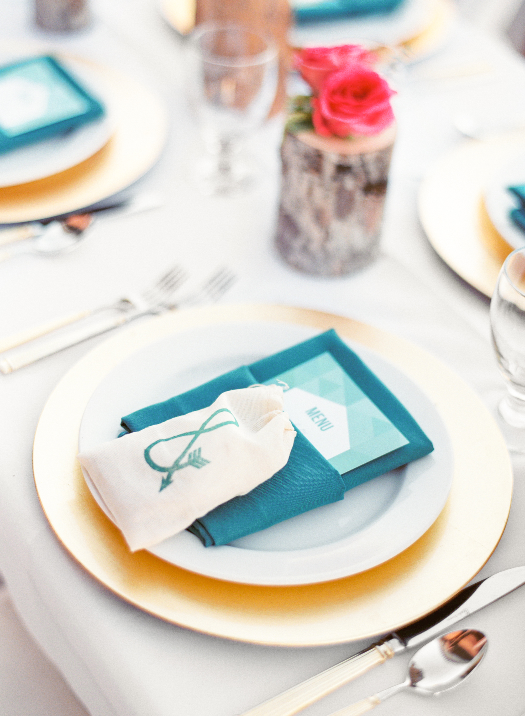 Spring, teal table setting with menu & s'mores favors in muslin bag