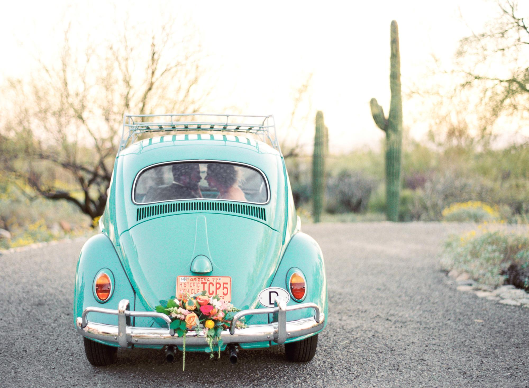Teal volkswagen beetle