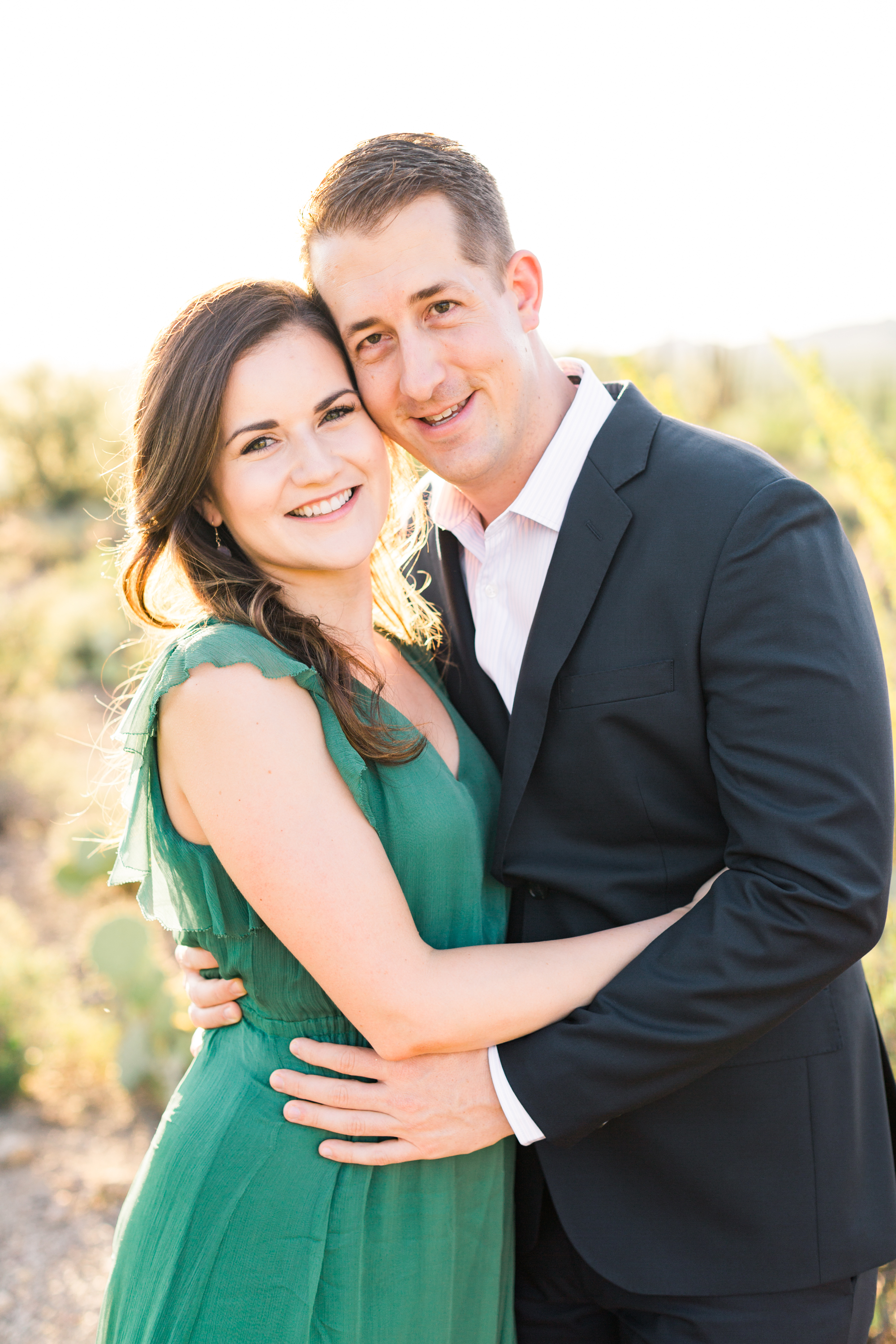 Gorgeous couple hugging at their Tucson desert engagement session