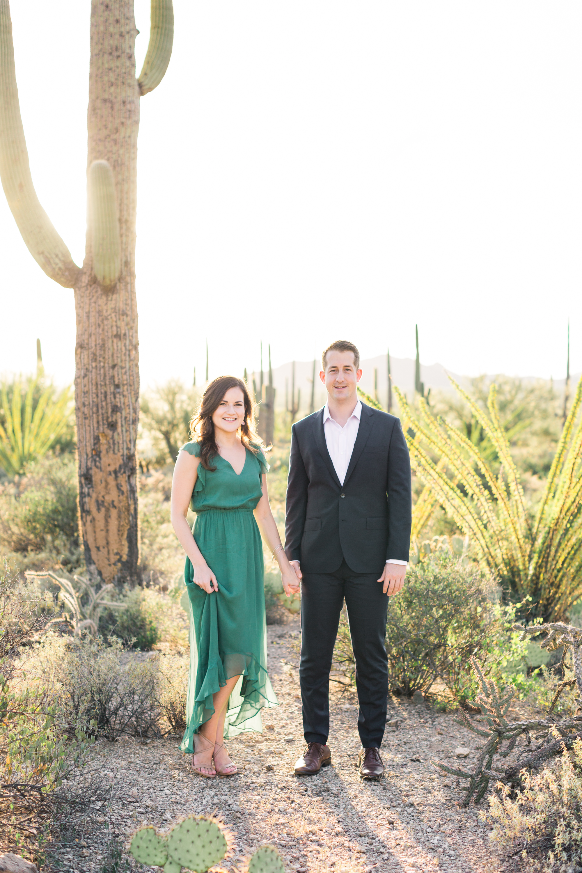 We love their outfits Alyssa & Dave chose for their engagement session. Her green dress compliments the gorgeous desert gorgeous desert tones perfectly.