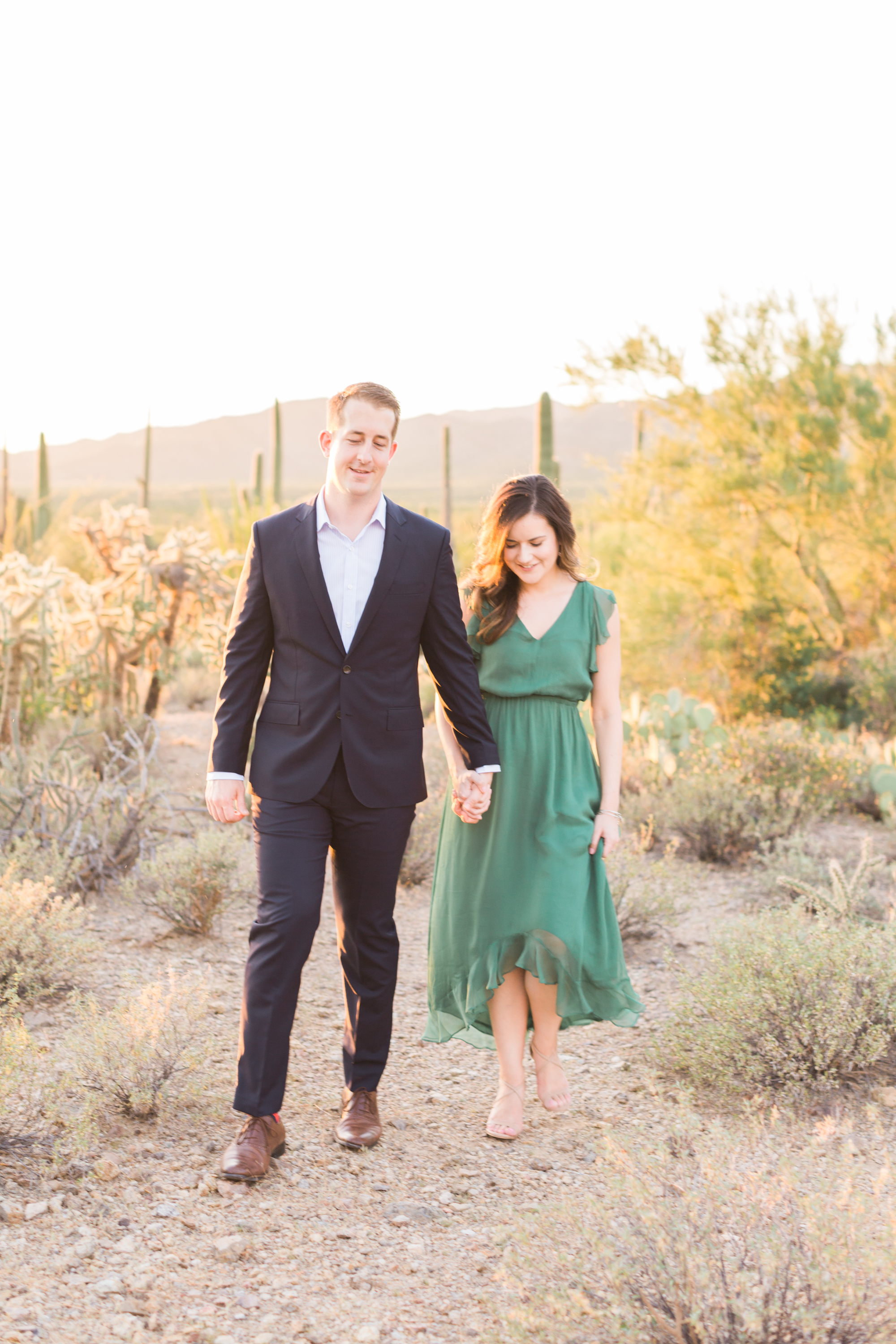 Couple walking in the desert holding hands!