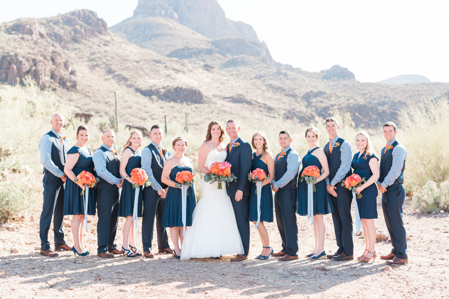 Gorgeous Wedding party in navy standing in front of the gorgeous mountain backdrops at Tucson wedding venue, Stardance.