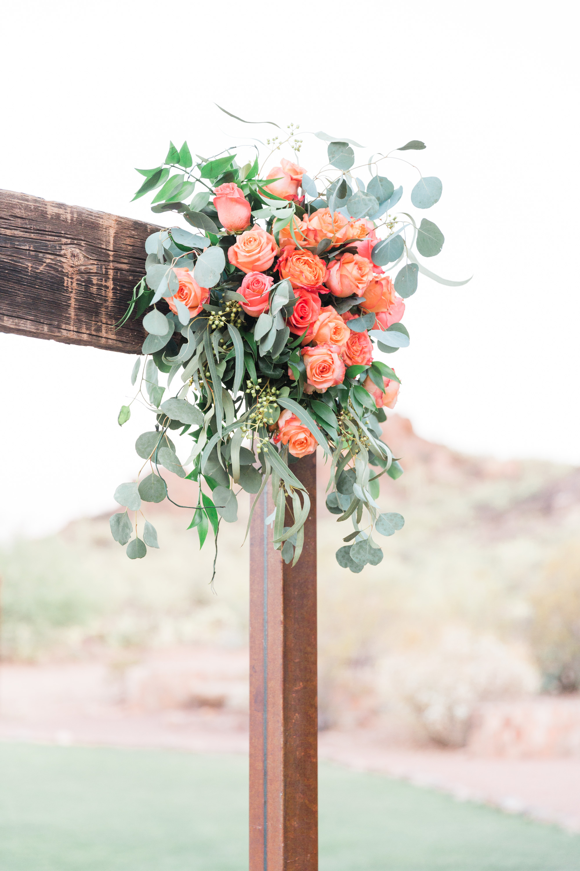 Beautiful arbor draped with florals as you walk into the ceremony site.
