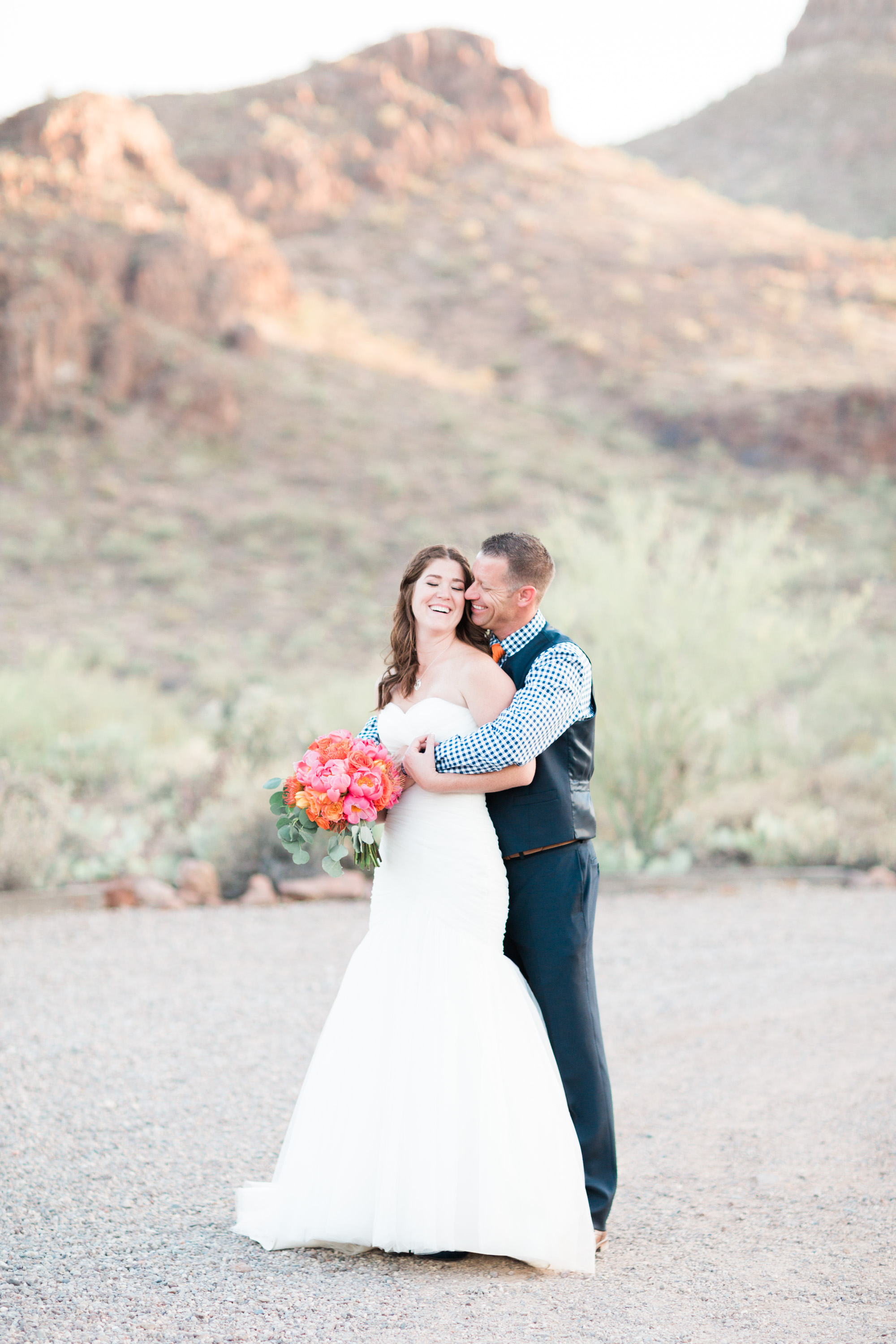 Bride and groom photos in front of the gorgeous mountain backdrops at Stardance wedding venue in Tucson. What a perfect spot for a Tucson wedding!