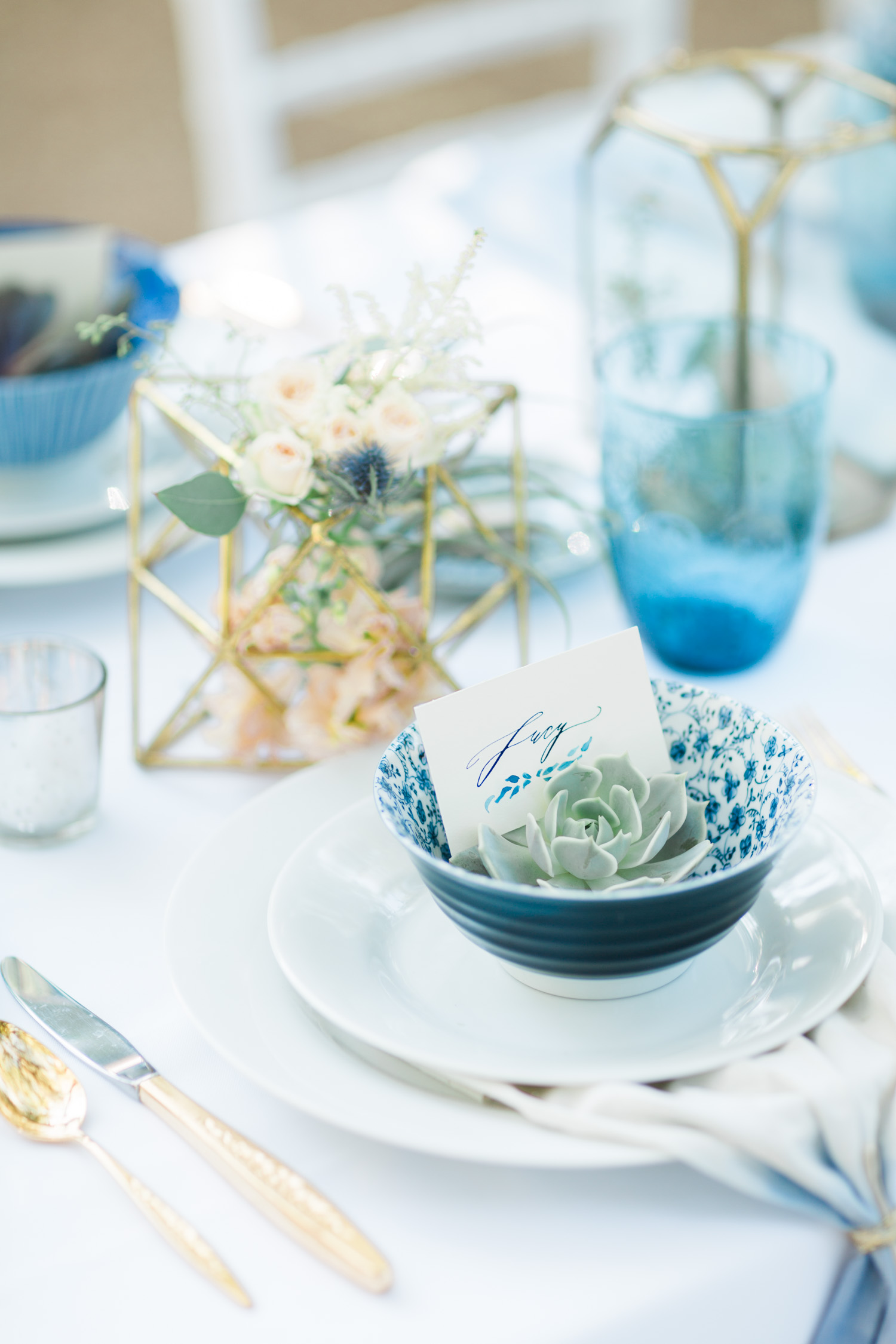 Indigo and gold place settings with stunning calligraphy by Betsy Dunlap