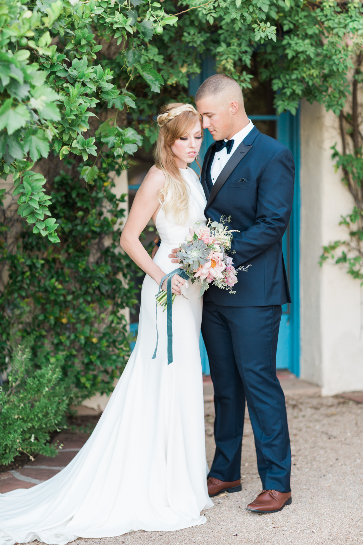 Couple embracing at Tohono Chul wedding in Tucson, Arizona