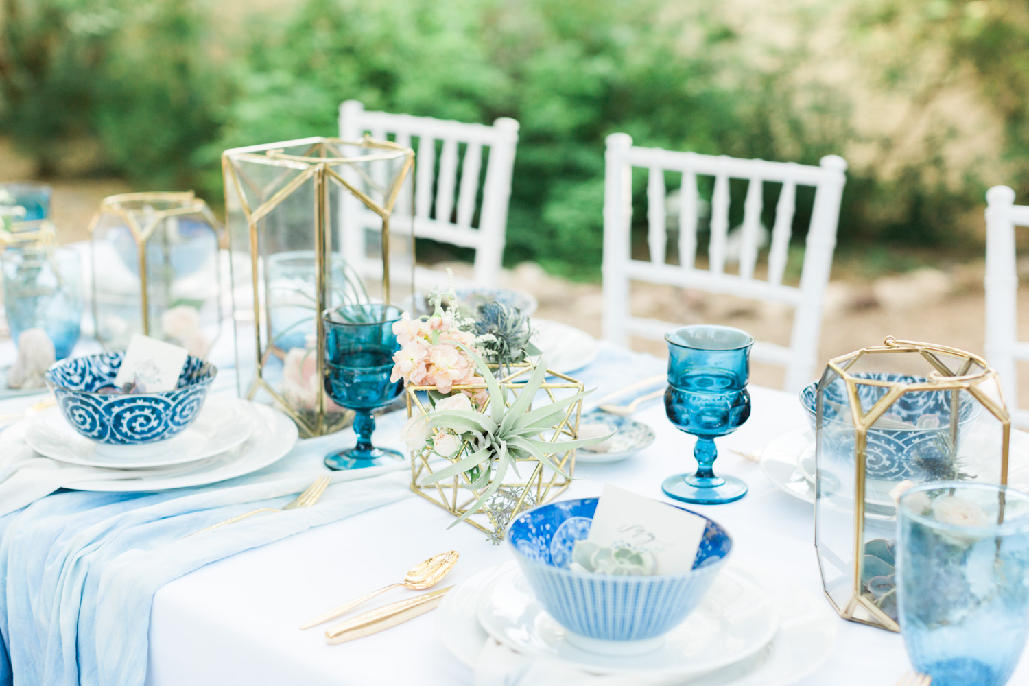 Bohemian indigo table setting with gold flatware