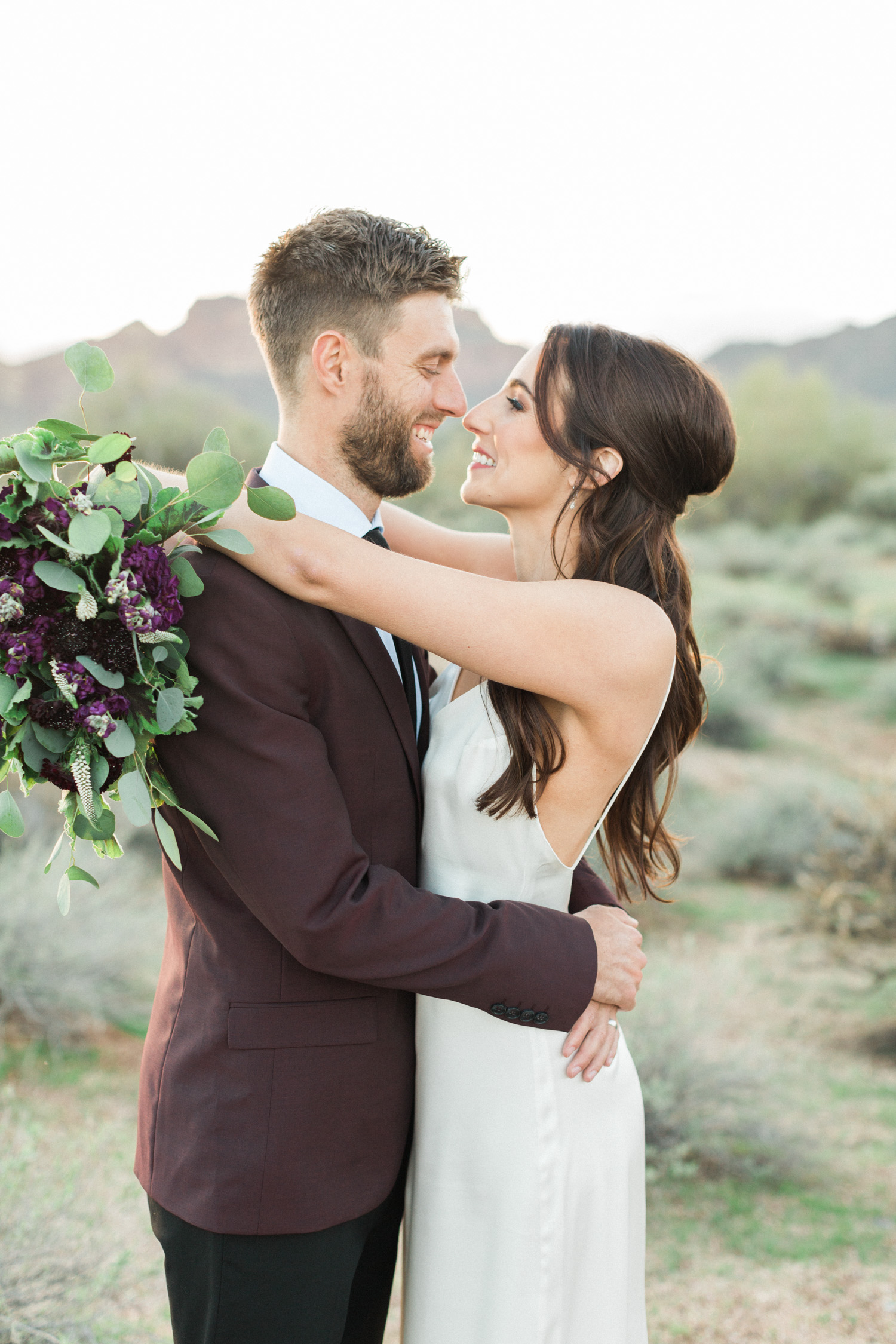 Beautiful couple smiling at each other on the day of their elopement in Phoenix, AZ.
