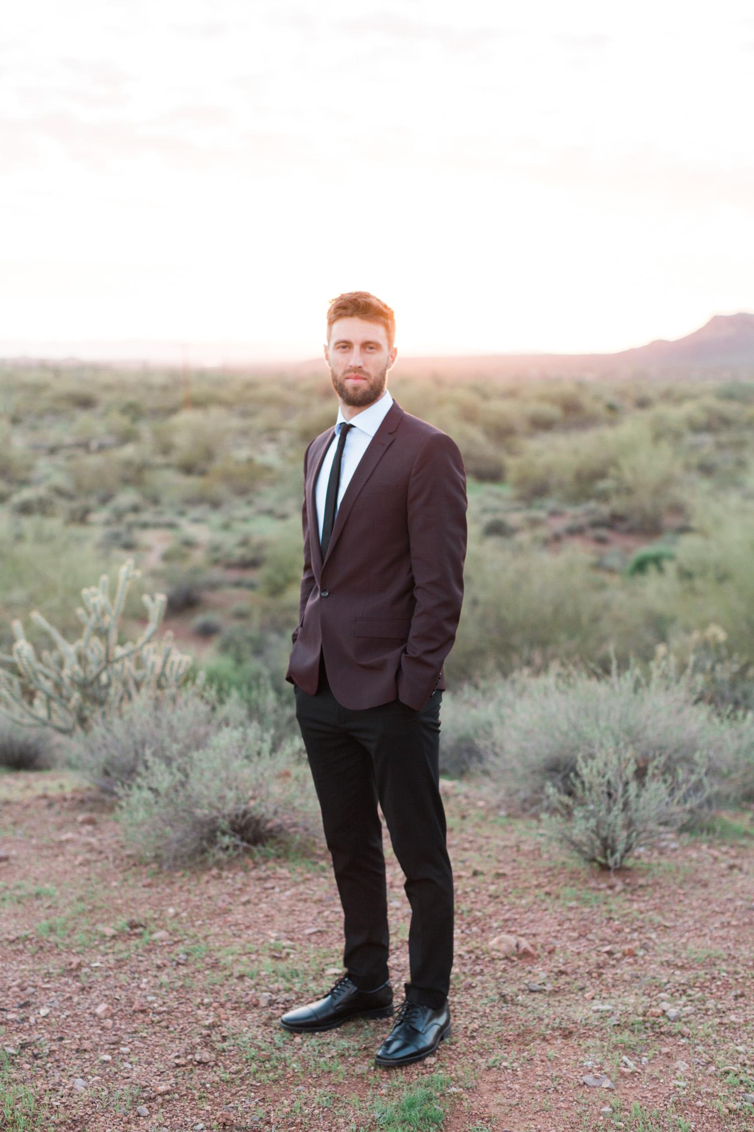 Hip groom in the desert on his wedding day in Phoenix, AZ.