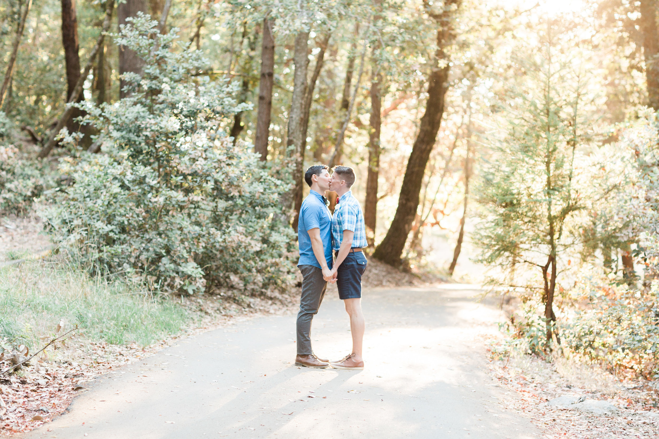 Two grooms kissing in the forest on their wedding day on Mount Tamalpais
