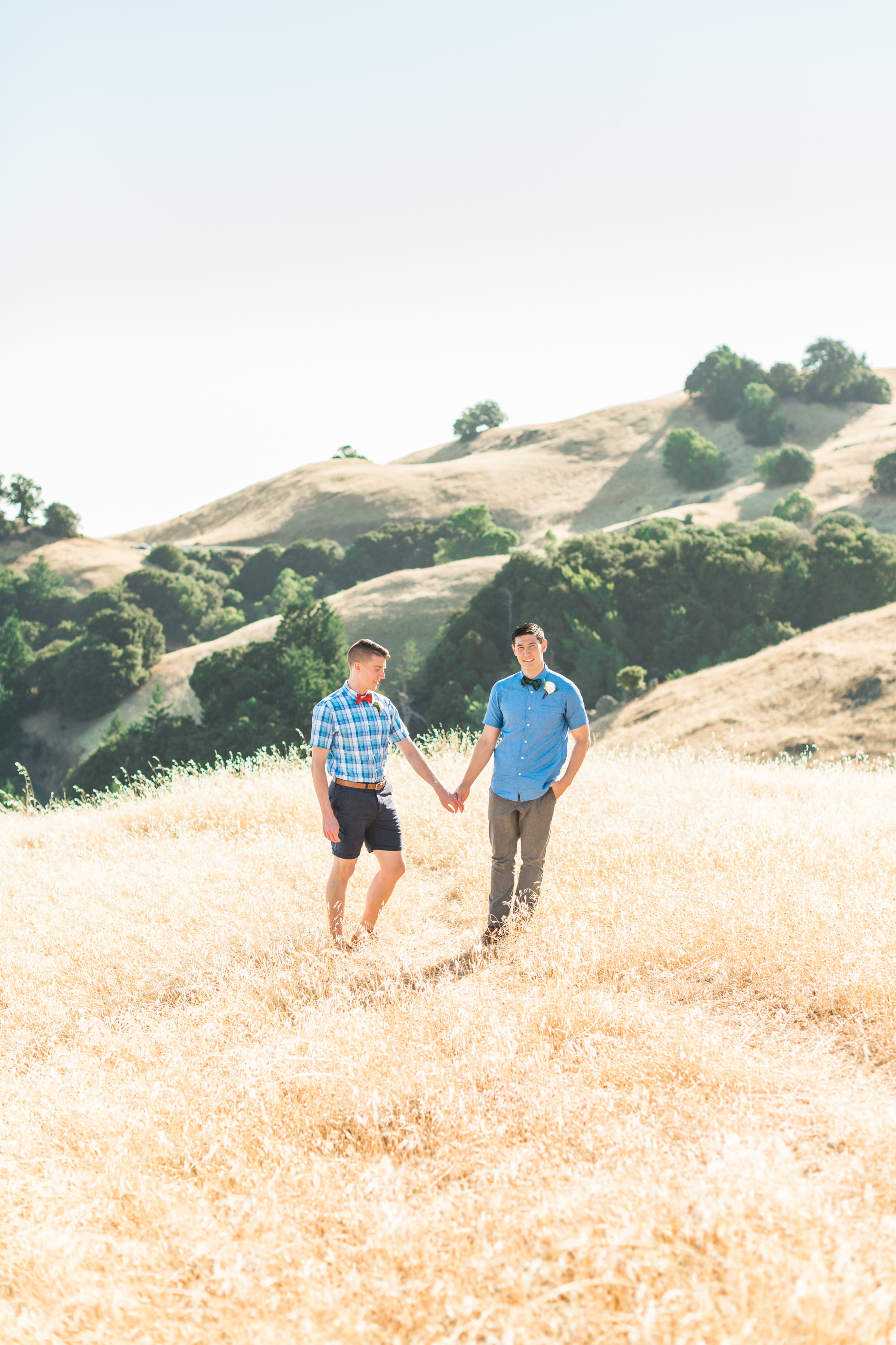 Two grooms in the rolling golden hills of Mount Tamalpais on their wedding day. Bay area wedding photographers Betsy & John