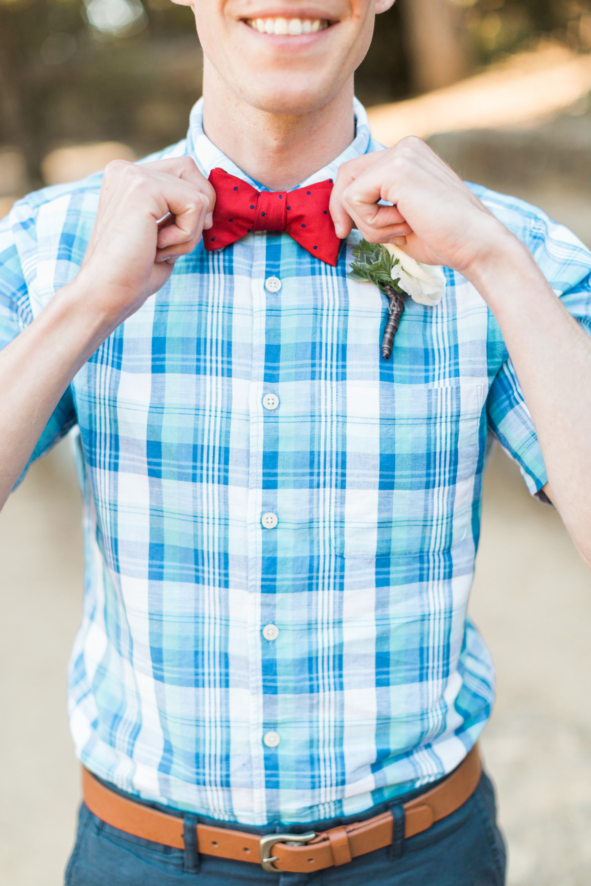 Groom straightening bowtie