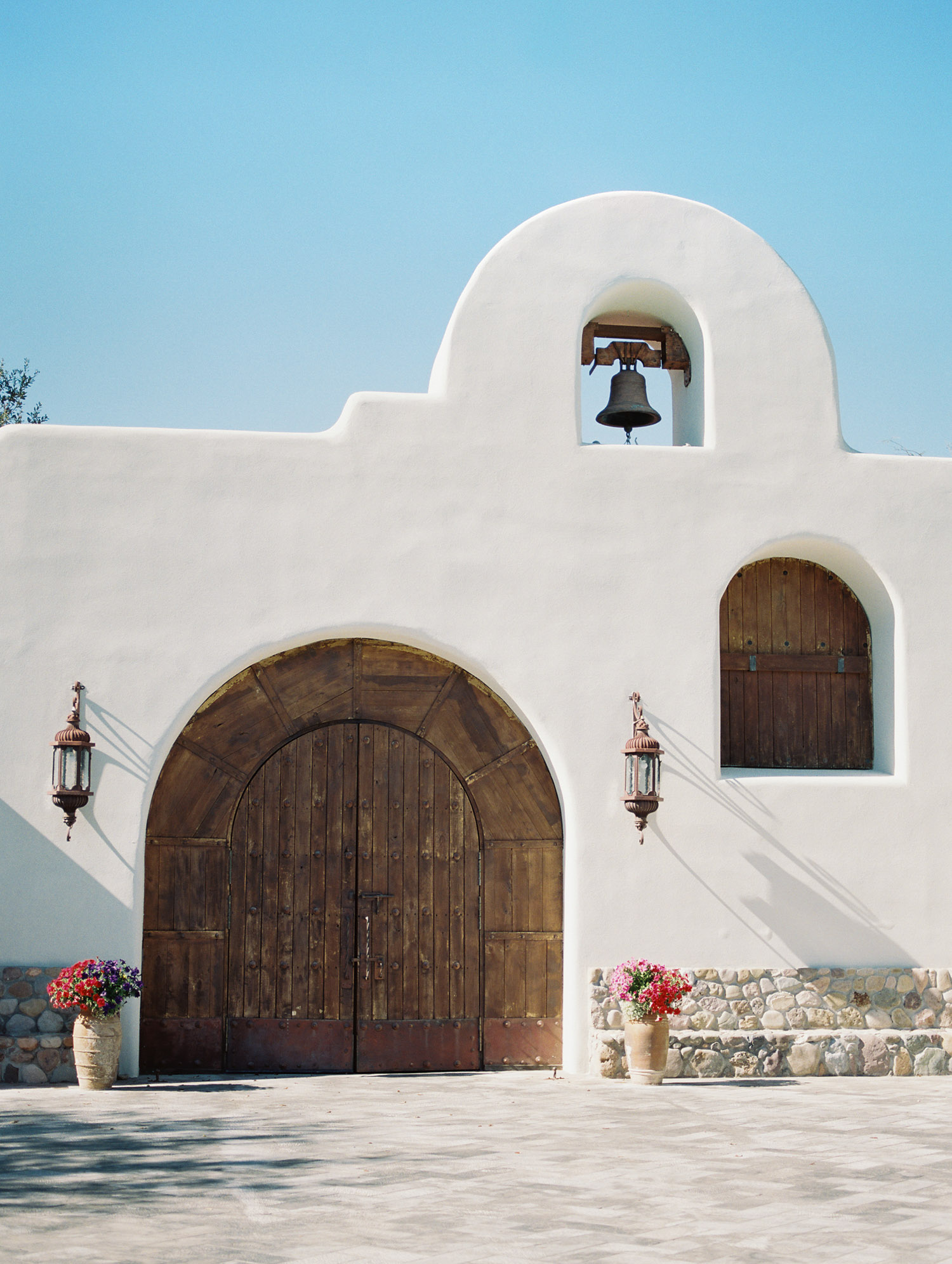 Gorgeous white chapel in the desert at Tubac Golf Resort. Capture by Tucson wedding photographers, Betsy & John.