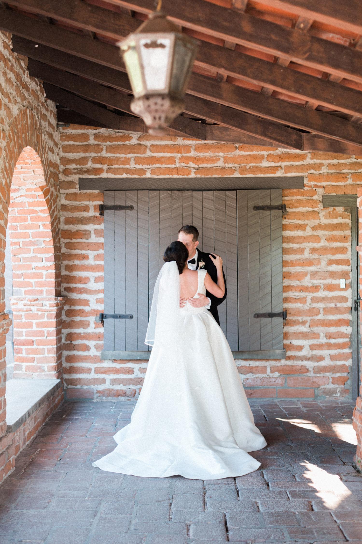 Bride and groom kiss at their Tubac Golf Resort wedding