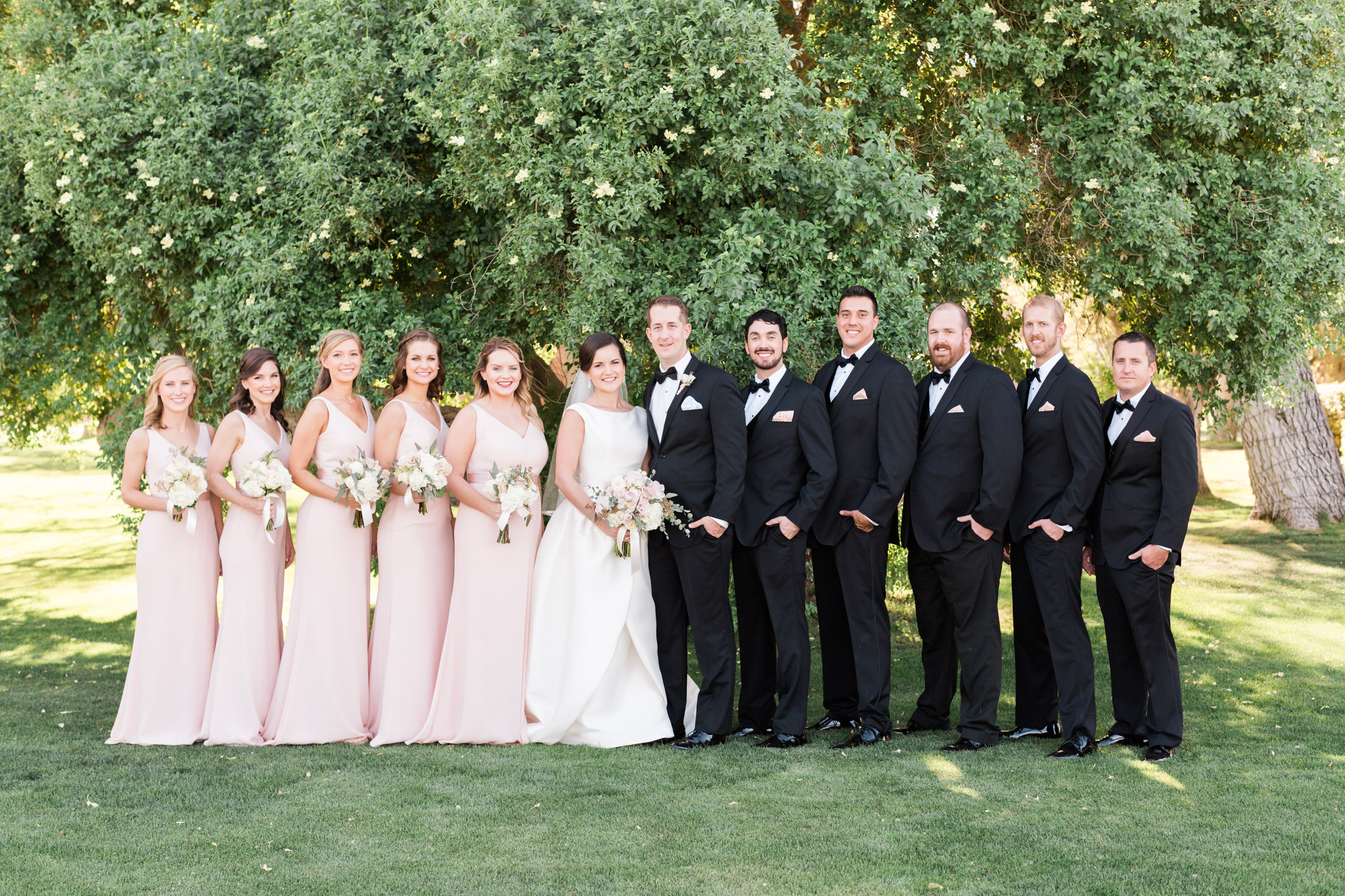 Wedding Party with bride & groom at the gorgeous green Tubac Golf Resort in Tubac, Arizona. Captured by best Tucson wedding photographers, Betsy & John