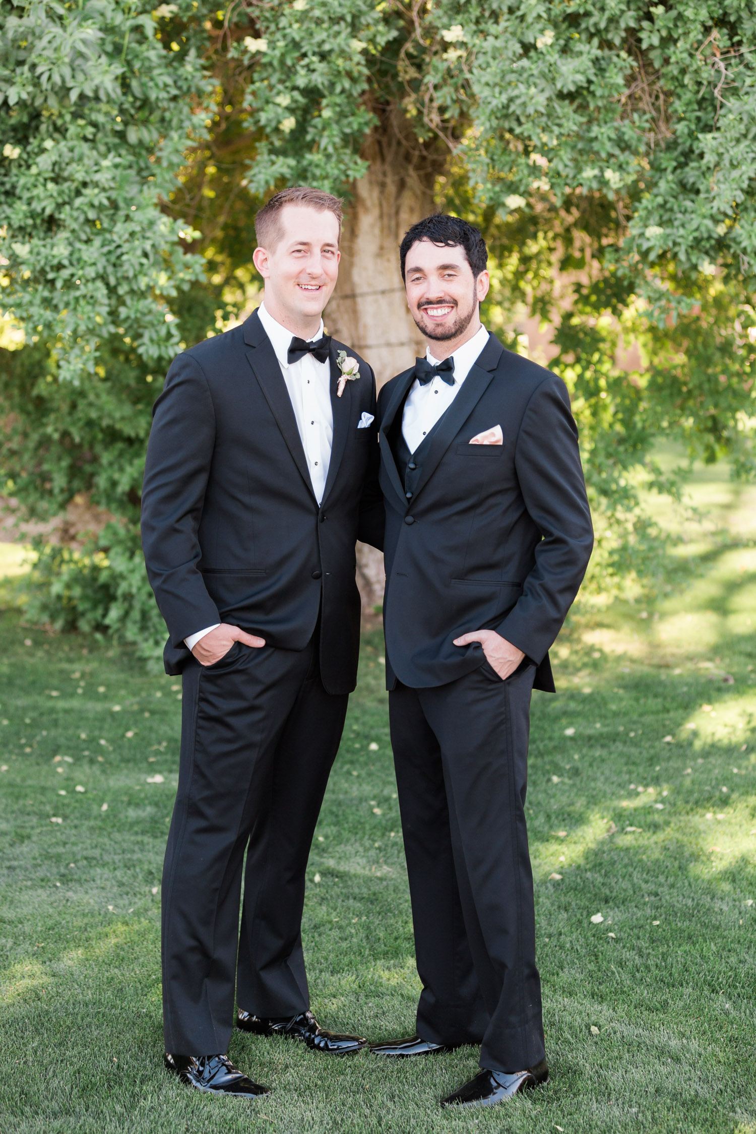 Groom with best man in black tuxedos