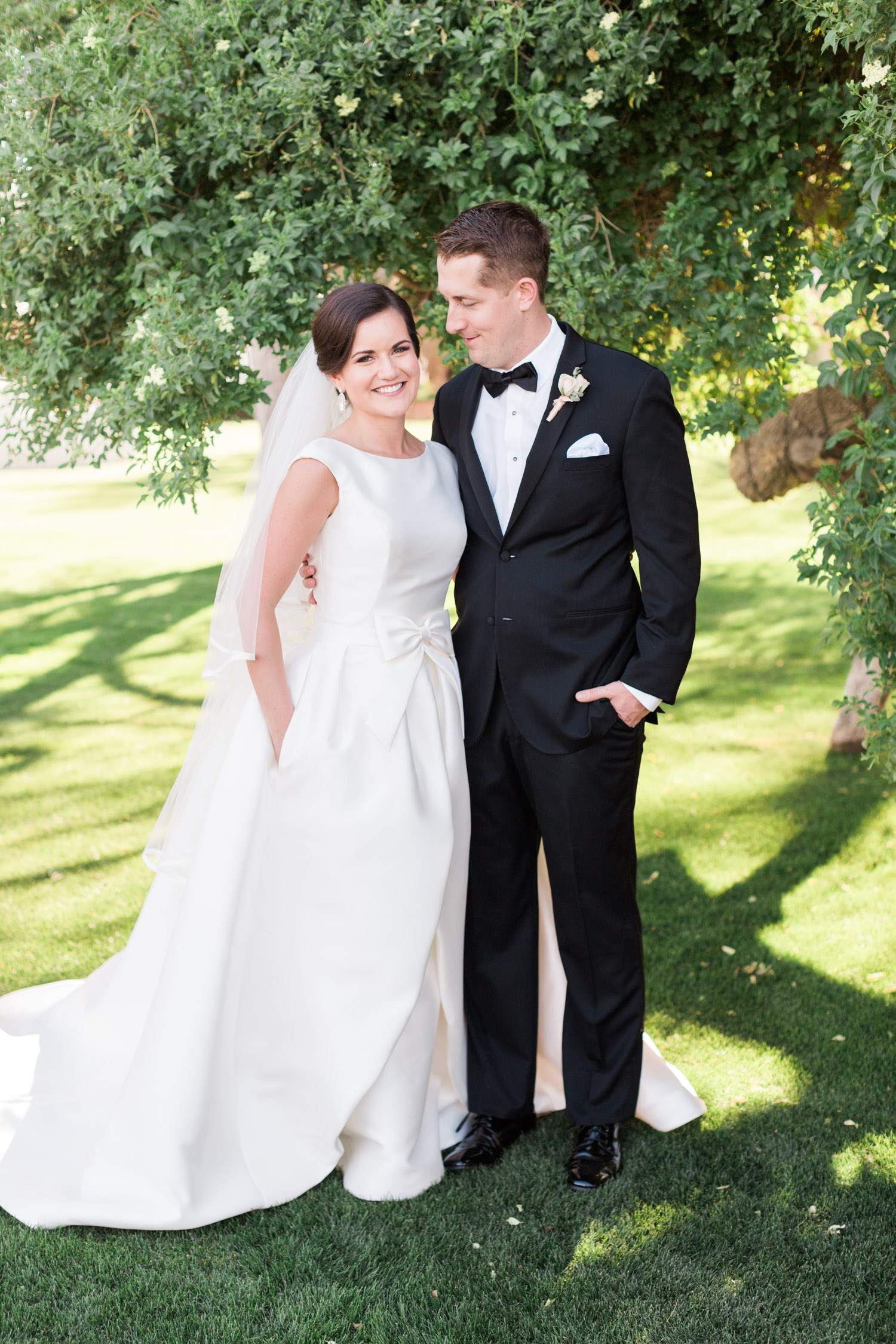 Bride & groom with hands in pockets. Wedding dress with pockets by Pronovias from Gigi Bridal