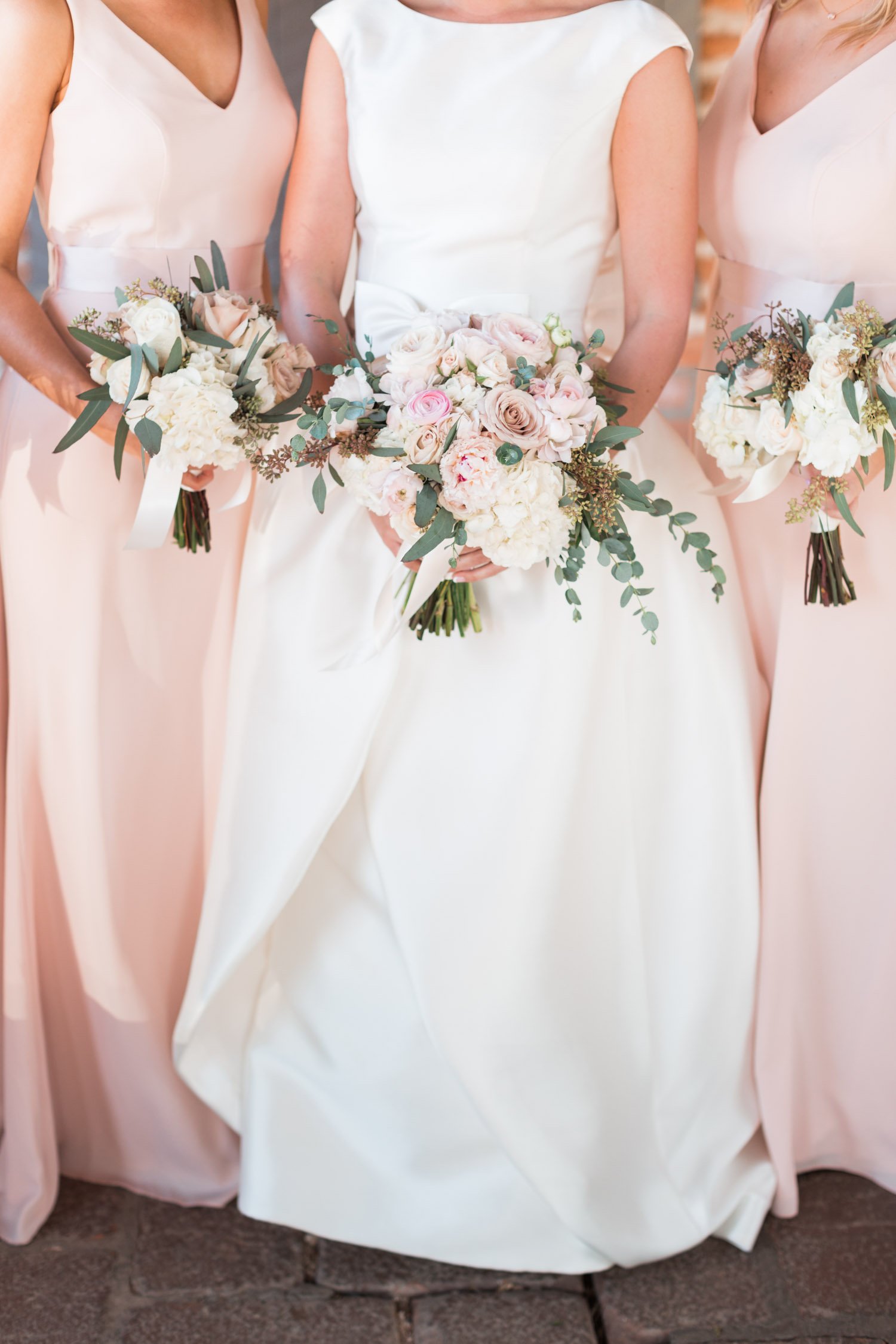 Blush and white bouquets with eucalyptus greenery
