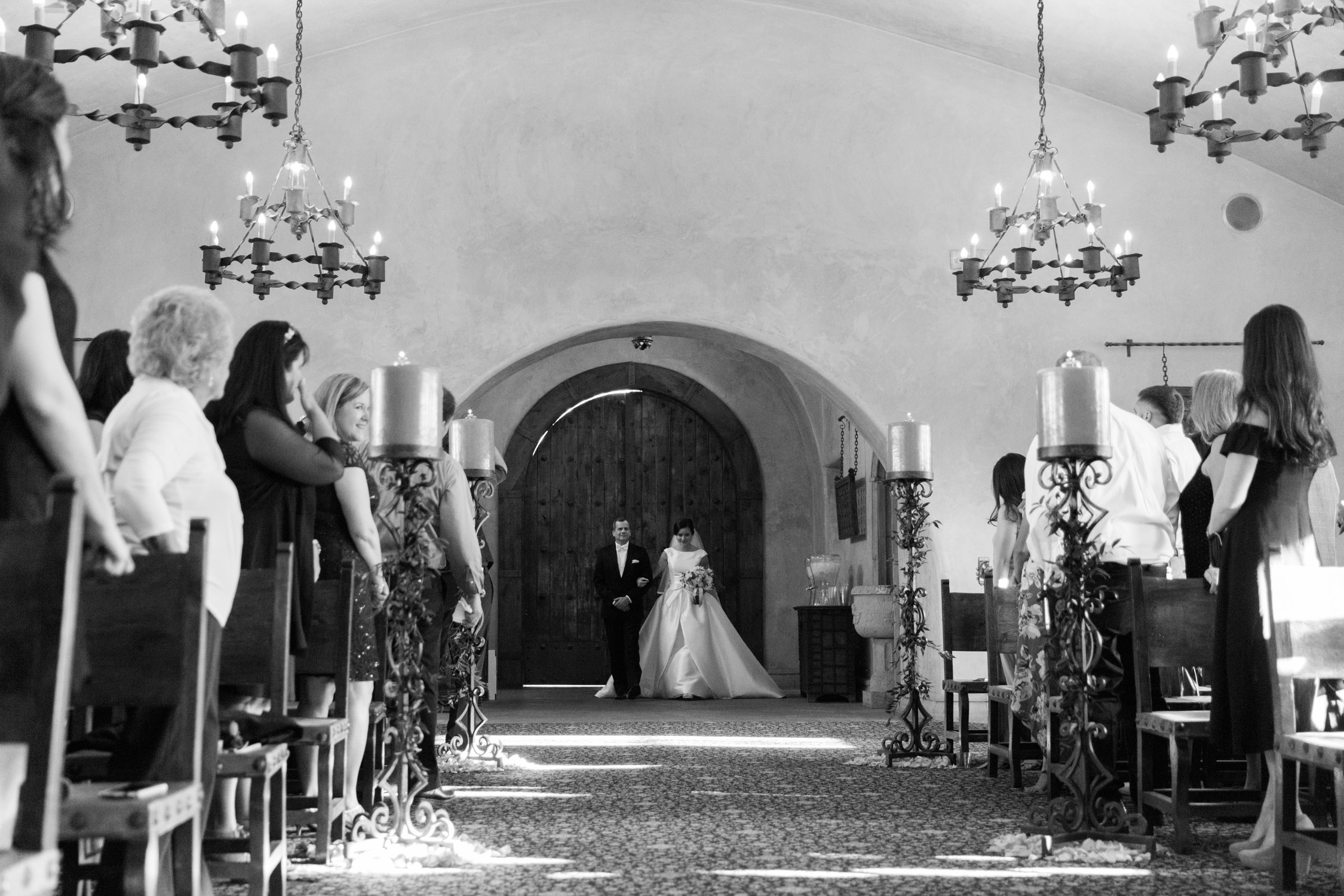 Father walking his daughter down the aisle in the gorgeous chapel at Tubac Golf Resort