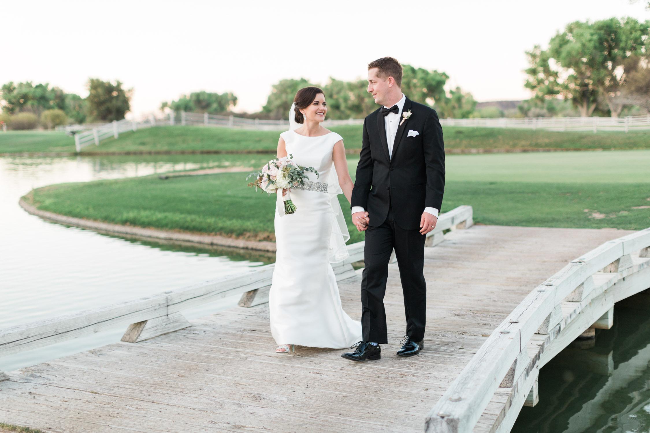 Walking across the bridge at wedding venue in Tubac