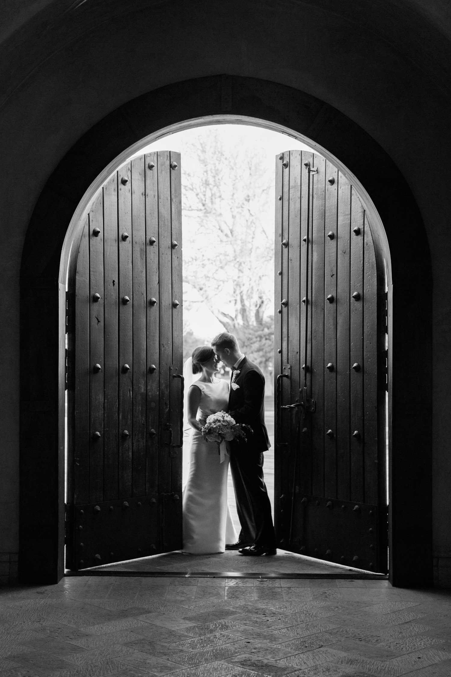 Chapel door silhouette of bride and groom