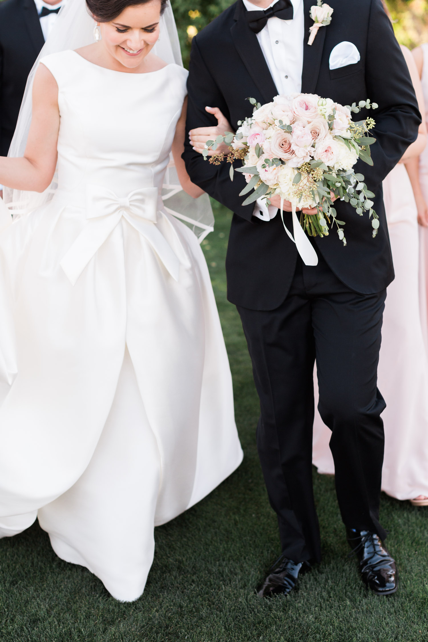 Smiling bride and groom with bridal party