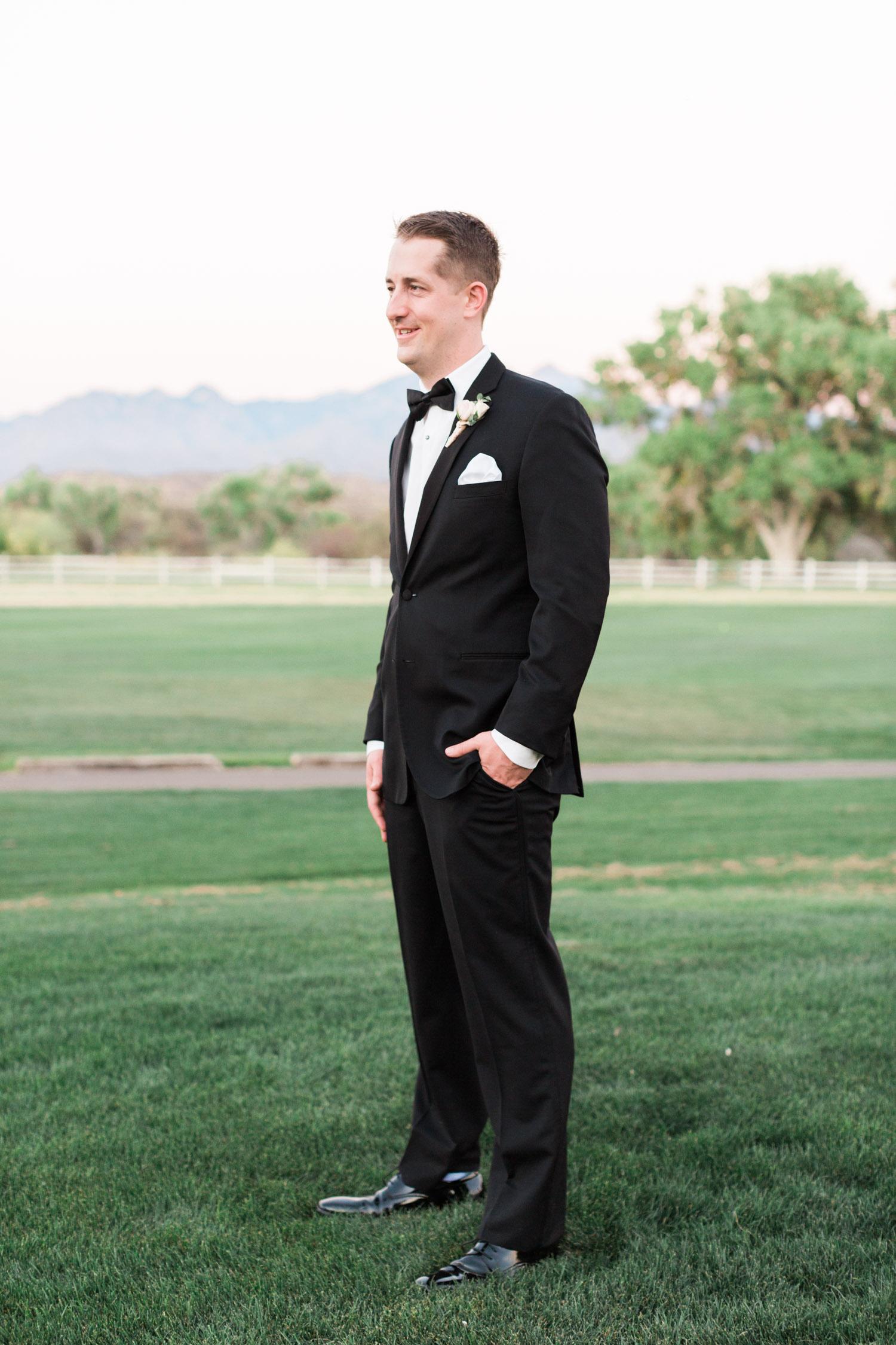 handsome groom in black tuxedo on his wedding day