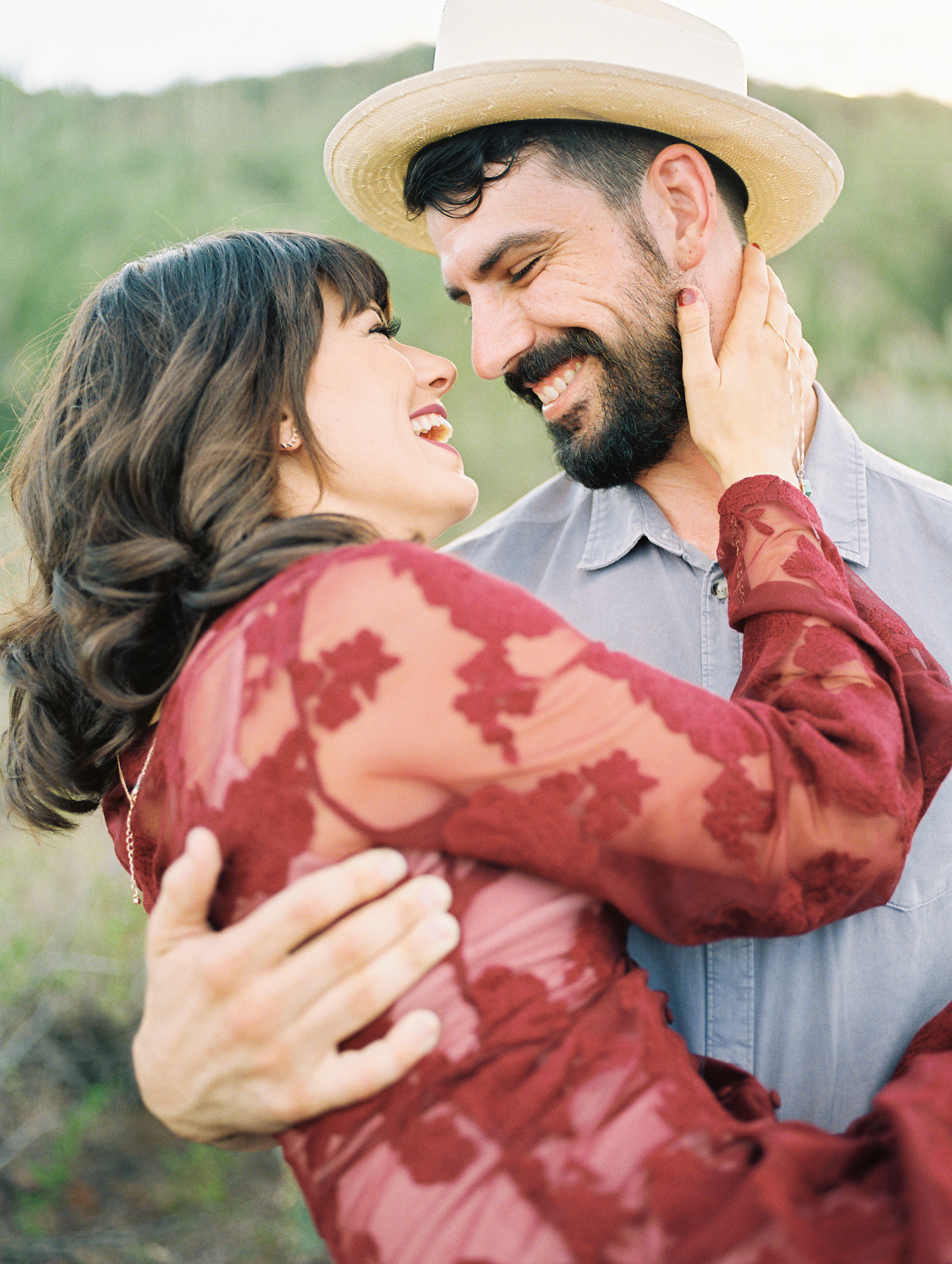 Groom holding bride smiling at each other