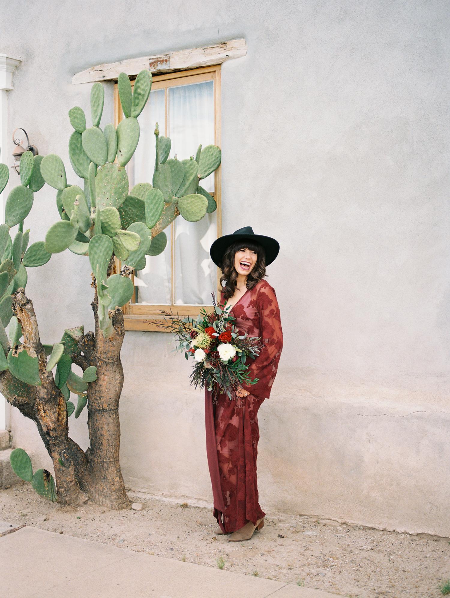 beautiful girl laughing holding bouquet