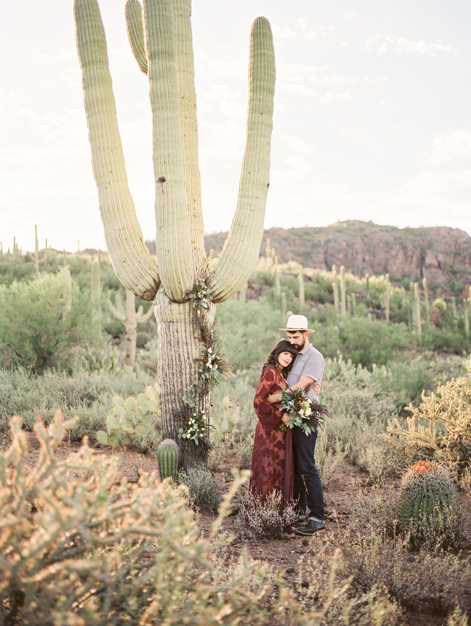 Gorgeous desert landscape with cute hipster couple captured by Tucson wedding photographers Betsy & John