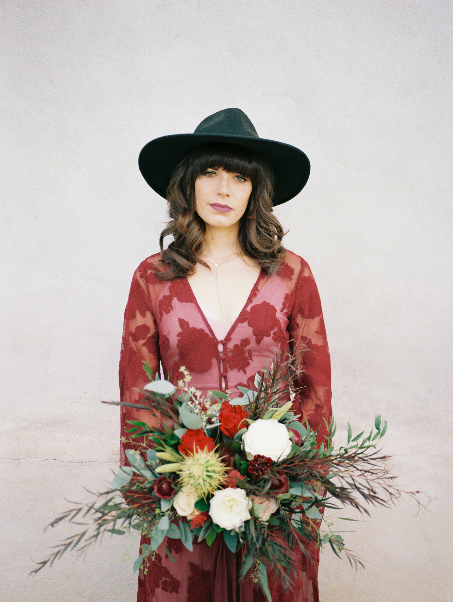 hipster bride in red wearing a black hat
