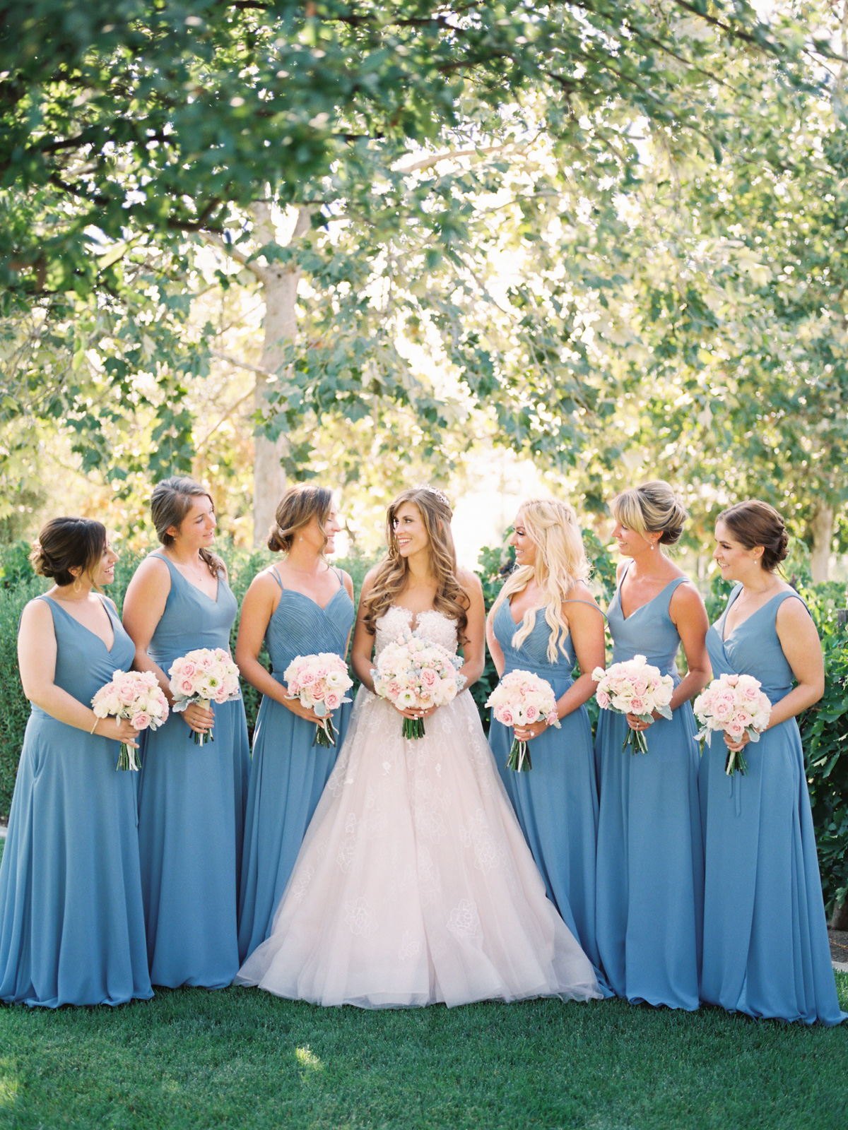 Bride with bridesmaids in blue   Harrison & Jocelyne's gorgeous Temecula wedding at Wiens Family Cellars captured by Betsy & John Photography