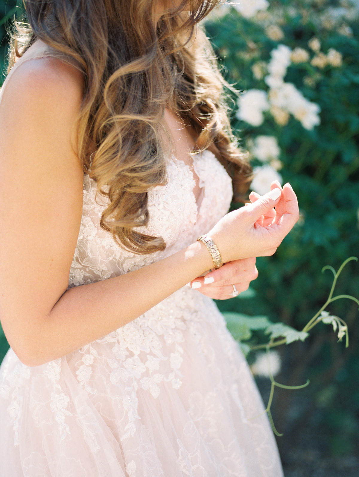 Bride wearing her grandmothers bracelet   Harrison & Jocelyne's gorgeous Temecula wedding at Wiens Family Cellars captured by Betsy & John Photography