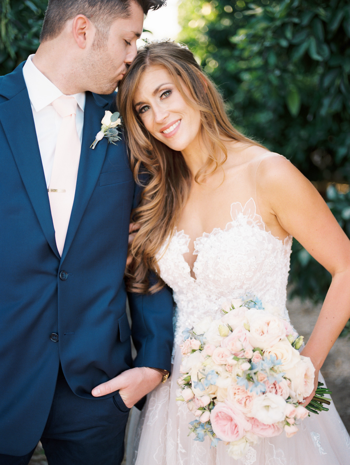 Groom kissing top of brides head  Harrison & Jocelyne's gorgeous Temecula wedding at Wiens Family Cellars captured by Betsy & John Photography   Temecula Film Photographers