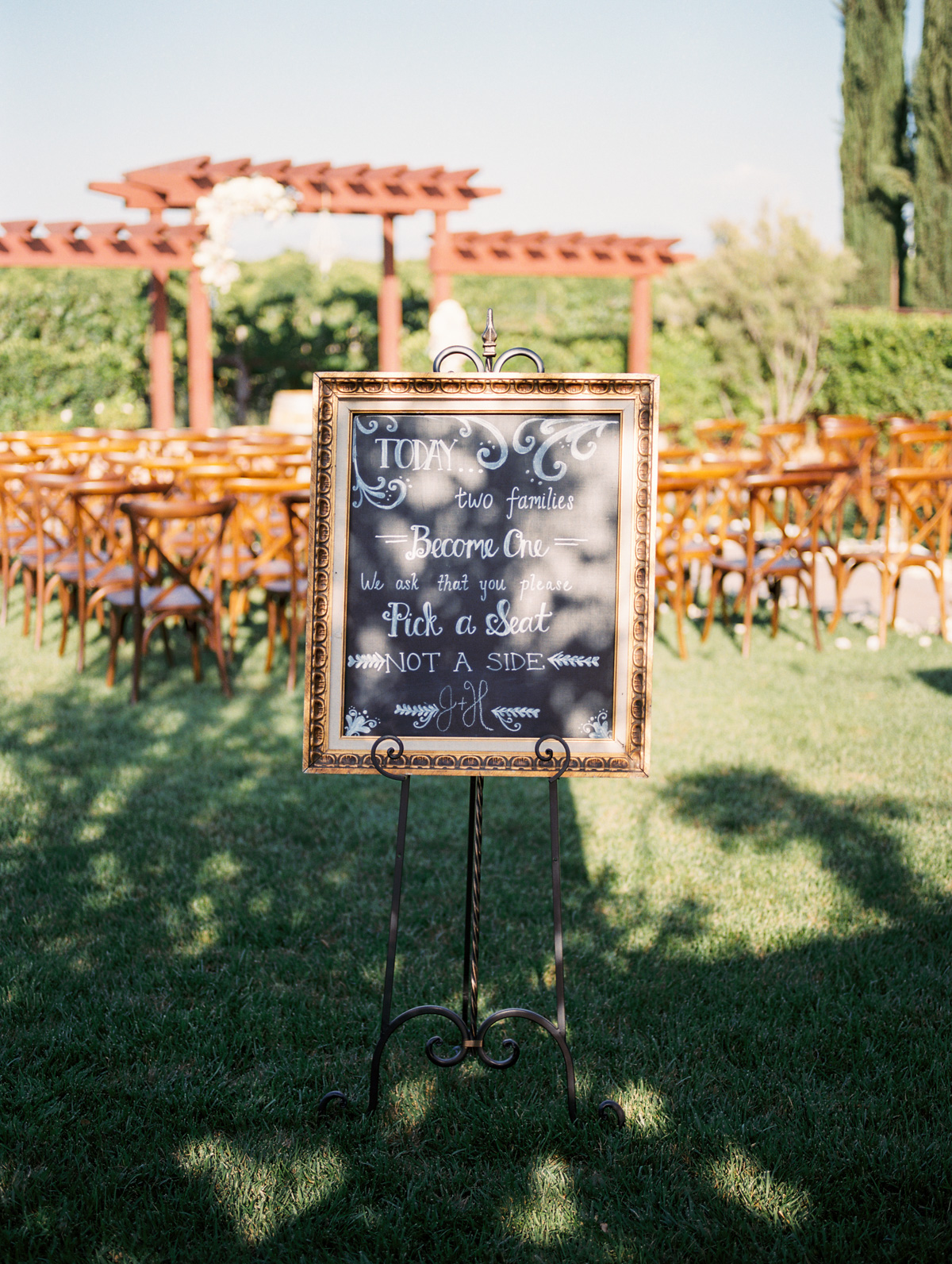 Wedding ceremony chalkboard at Harrison & Jocelyne's gorgeous Temecula wedding at Wiens Family Cellars captured by Betsy & John Photography | Temecula Film Photographers