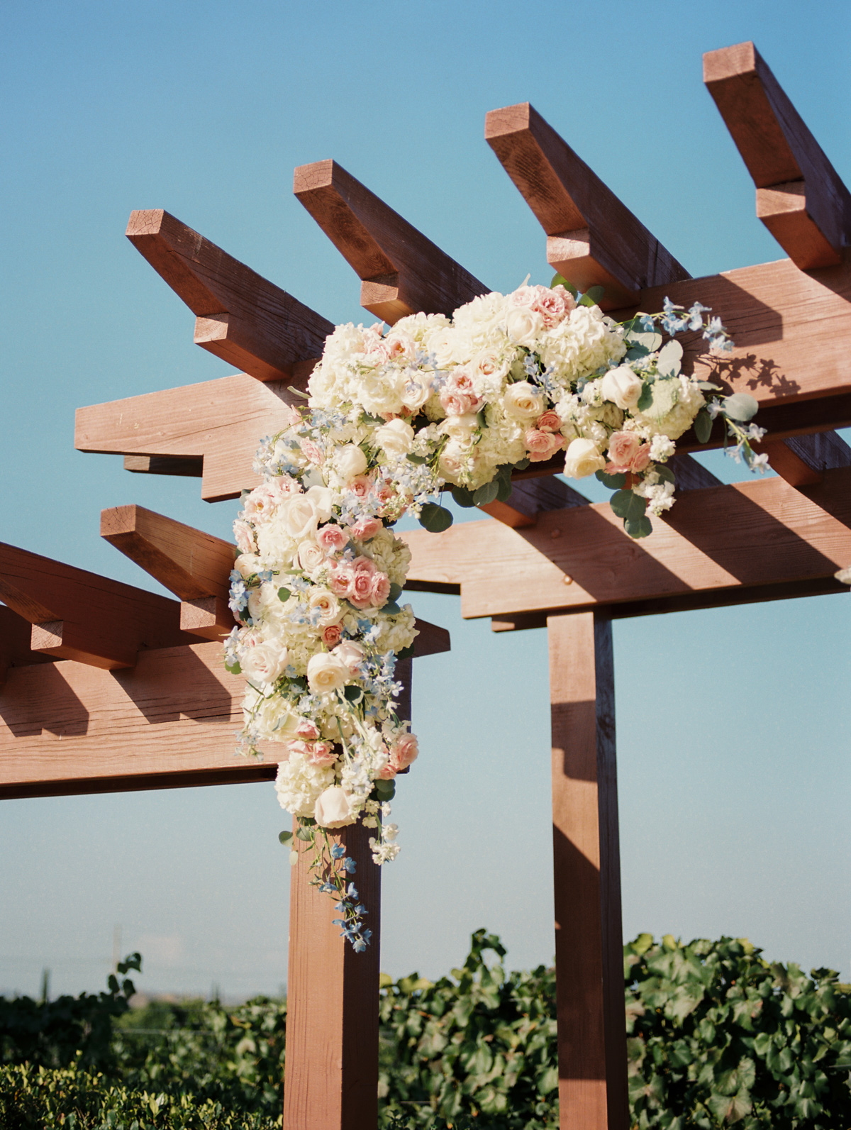 Floral arch by Soiree Design & Events |Harrison & Jocelyne's gorgeous Temecula wedding at Wiens Family Cellars captured by Betsy & John | Temecula Wedding Photographers