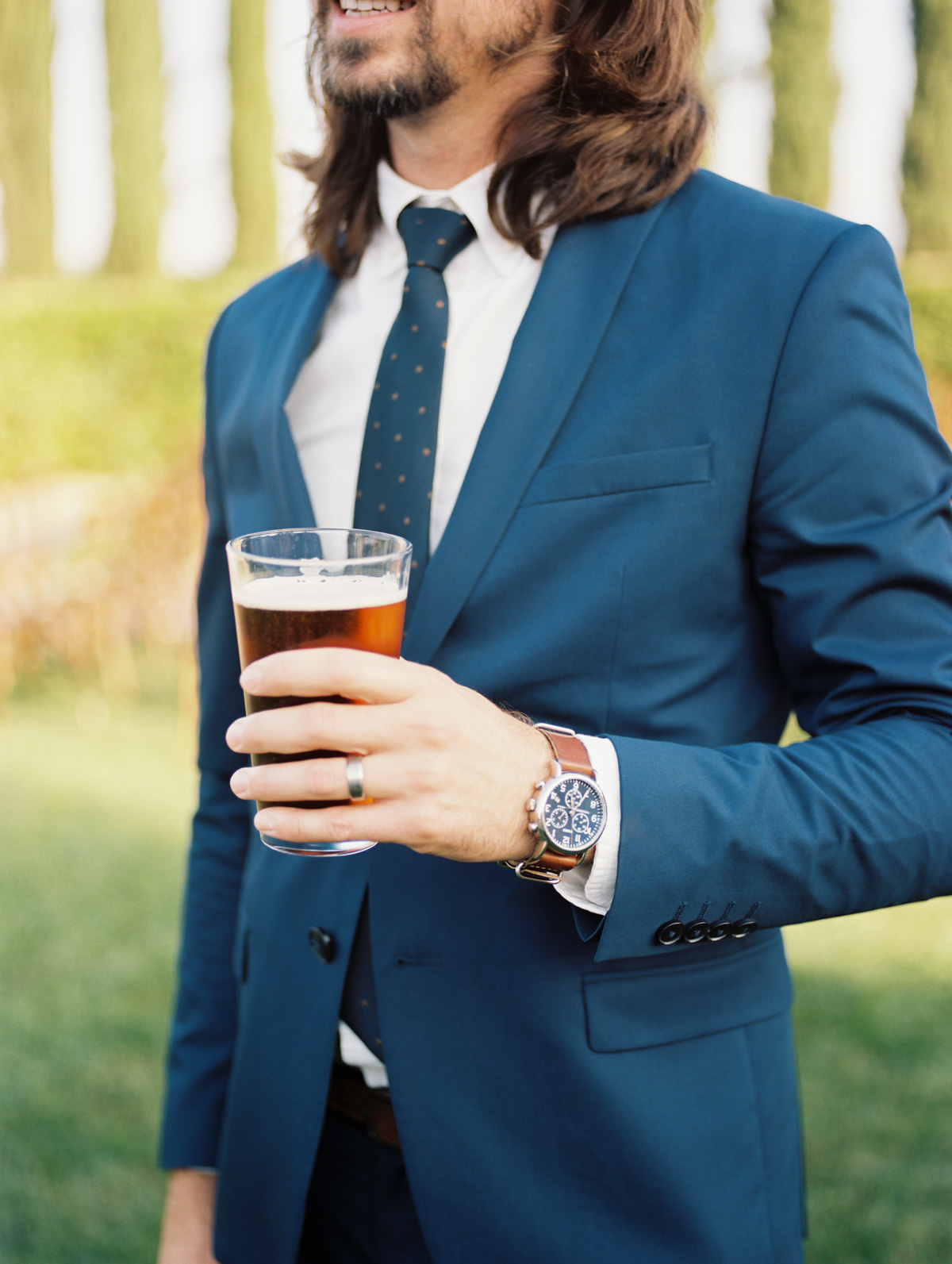 Craft beer drinker at Harrison & Jocelyne's gorgeous Temecula wedding day at Wiens Family Cellars captured by Temecula wedding photographers Betsy & John