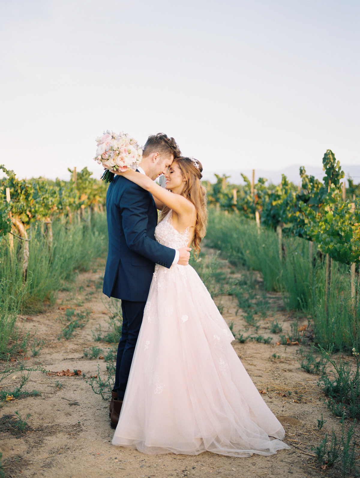 Harrison & Jocelyne's gorgeous Temecula wedding day at Wiens Family Cellars captured by Temecula wedding photographers Betsy & John