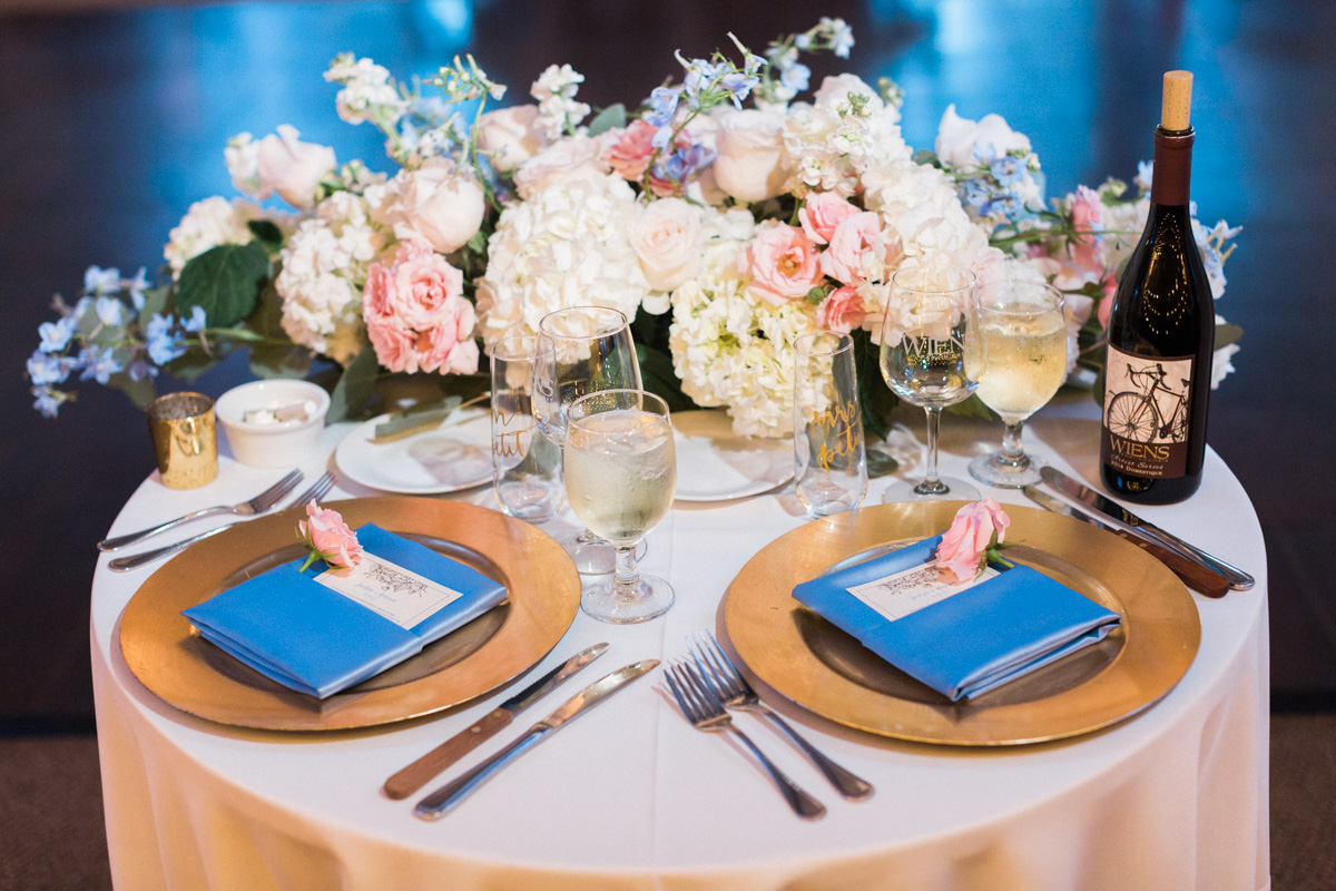Gorgeous sweetheart table with blue and blush tones  Harrison & Jocelyne's gorgeous Temecula wedding day at Wiens Family Cellars captured by Temecula wedding photographers Betsy & John