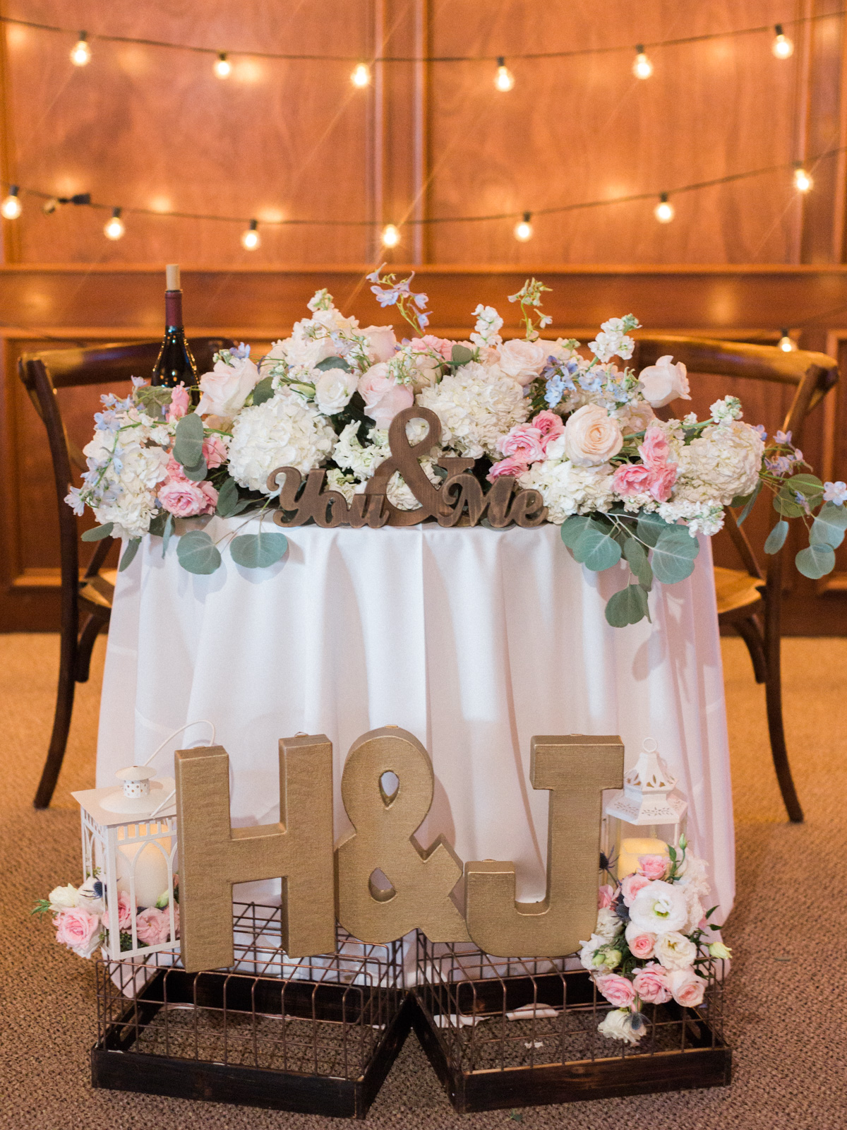 Gorgeous sweetheart table with florals by Soiree Design & Events |Harrison & Jocelyne's gorgeous Temecula wedding day at Wiens Family Cellars captured by Temecula wedding photographers Betsy & John