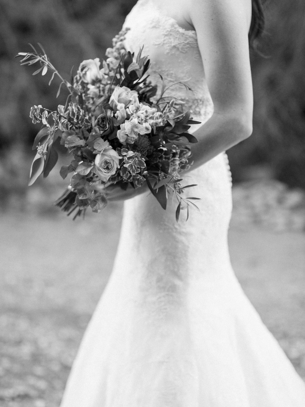 black and white photo of bride holding florals