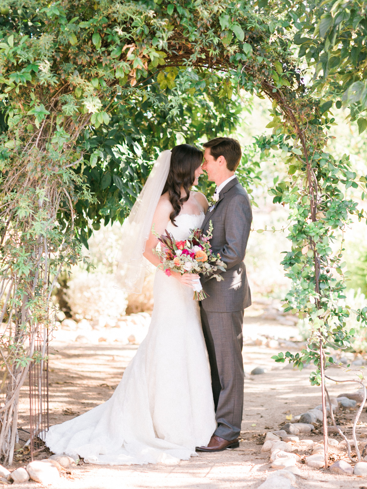Adorable couple captured by Phoenix wedding photographers, Betsy & John