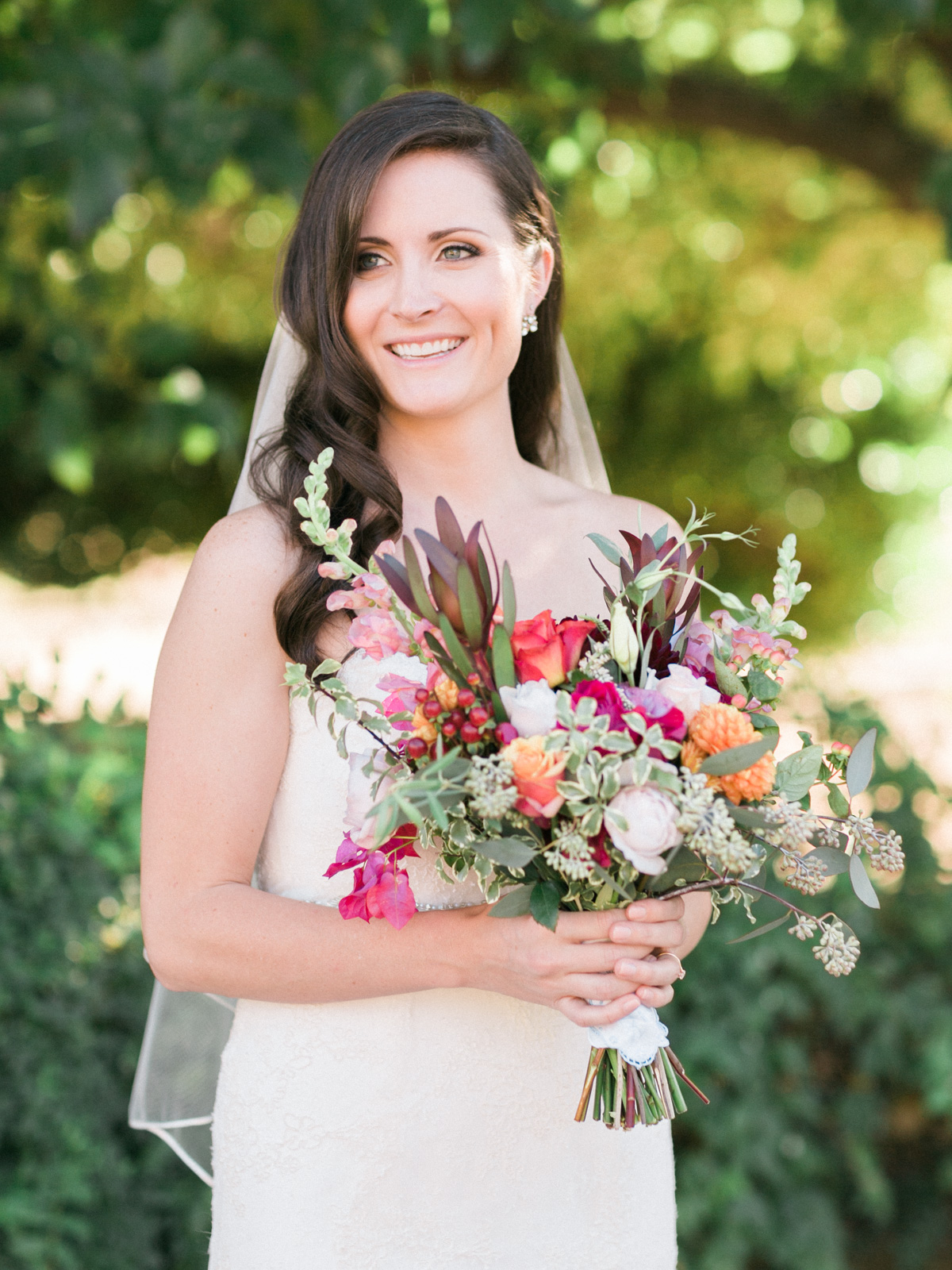 Gorgeous bride smiling captured by Phoenix wedding photographers, Betsy & John