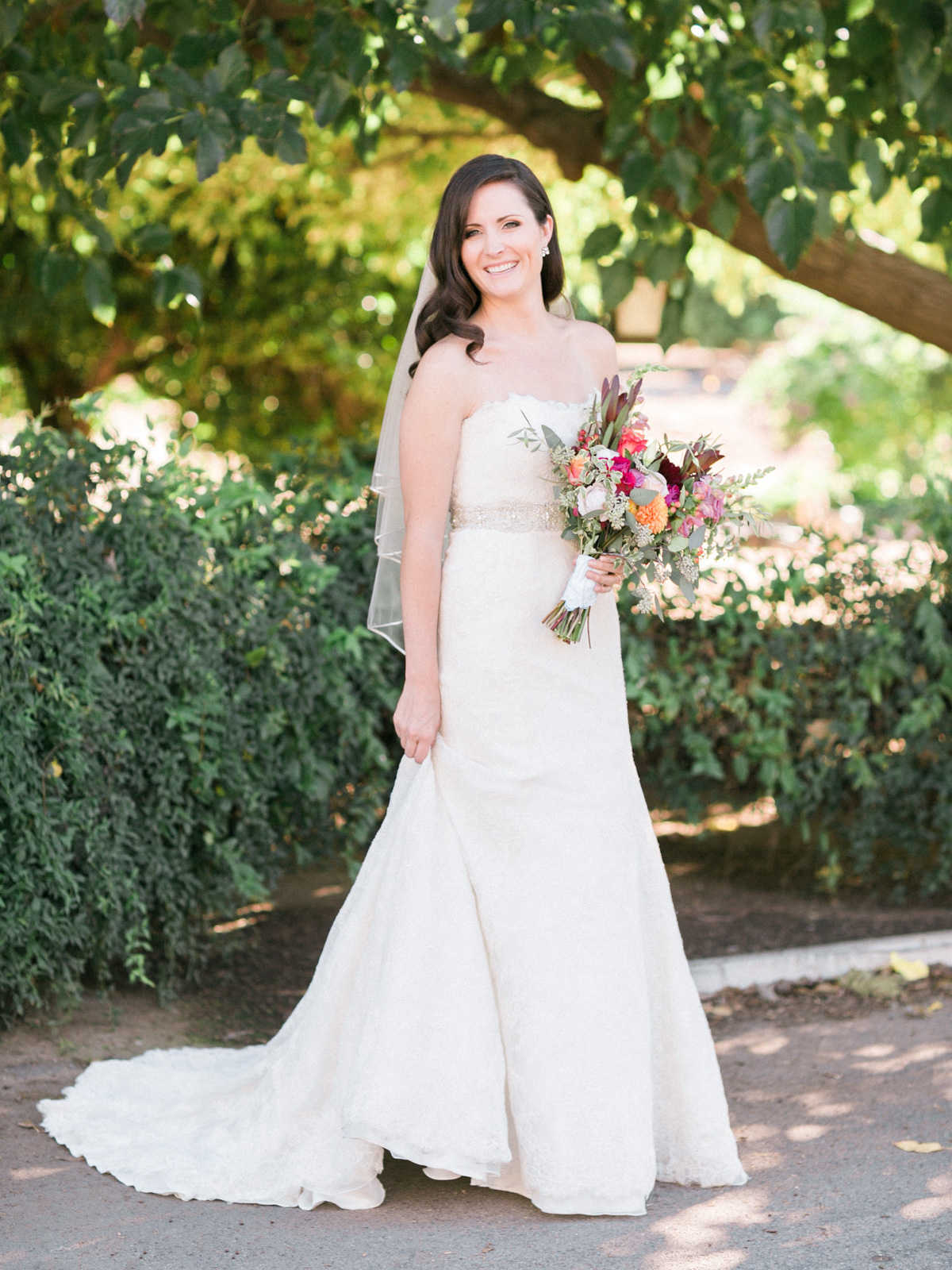 Gorgeous bride with jewel tone bouquet captured by Phoenix wedding photographers, Betsy & John