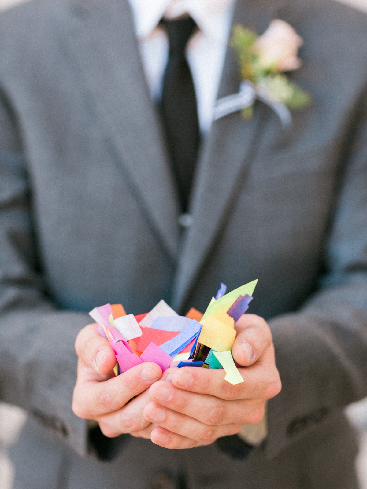 Groom holding confetti for confetti exit